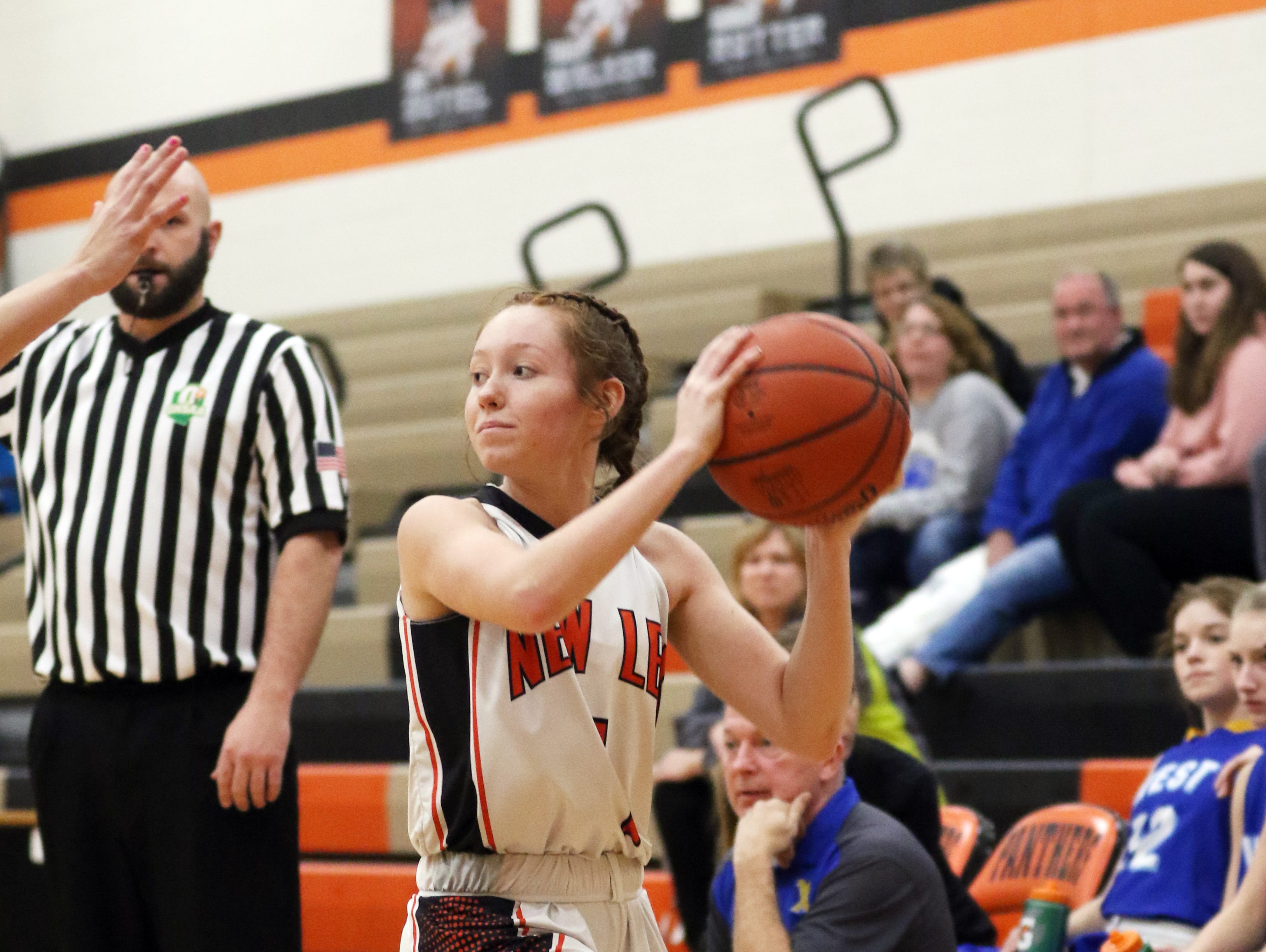 New Lexington's Kenadee Dillon looks for an open teammate against West Muskingum.