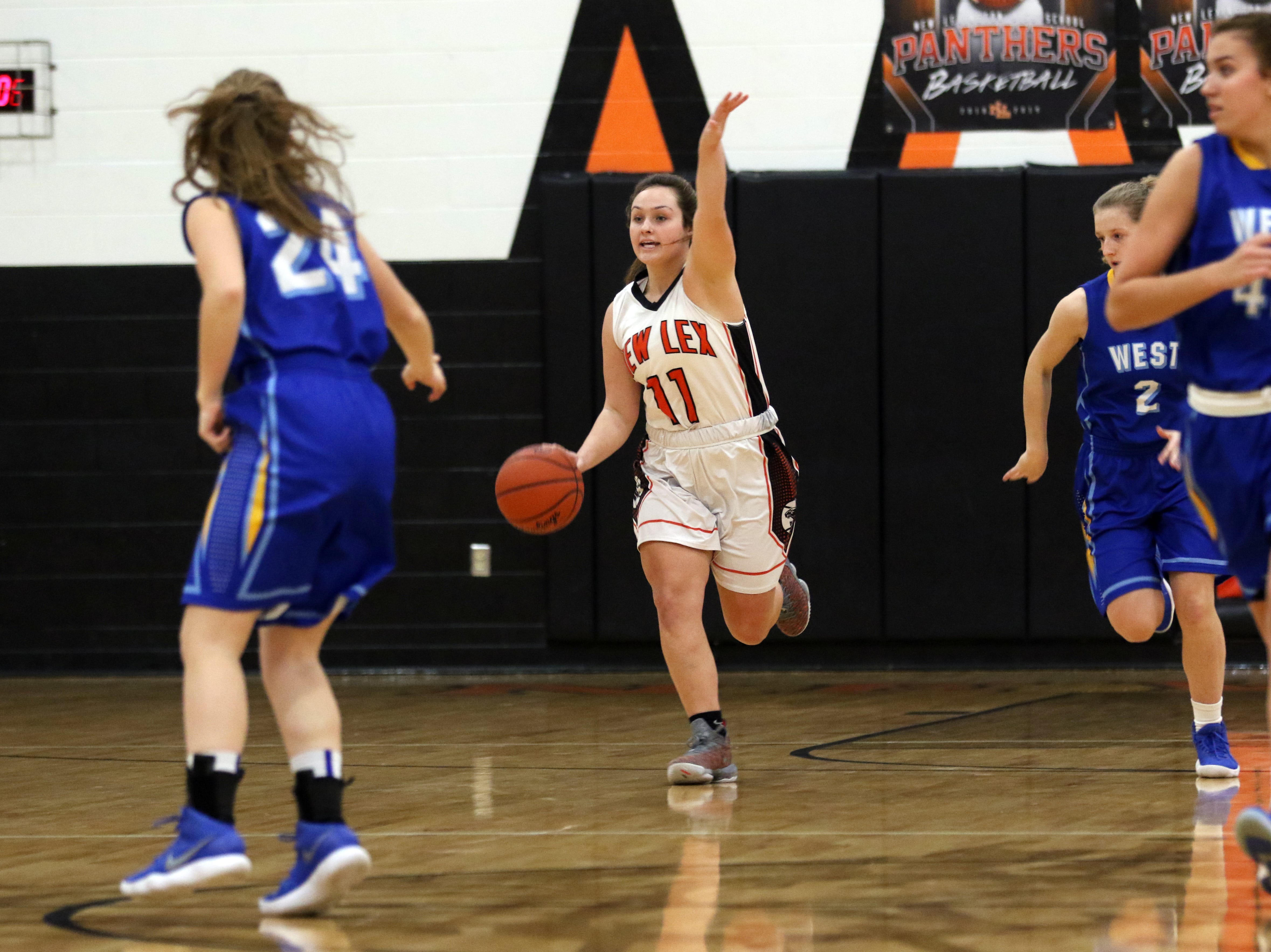 New Lexington's Haleigh Sammons calls a play against West Muskingum.