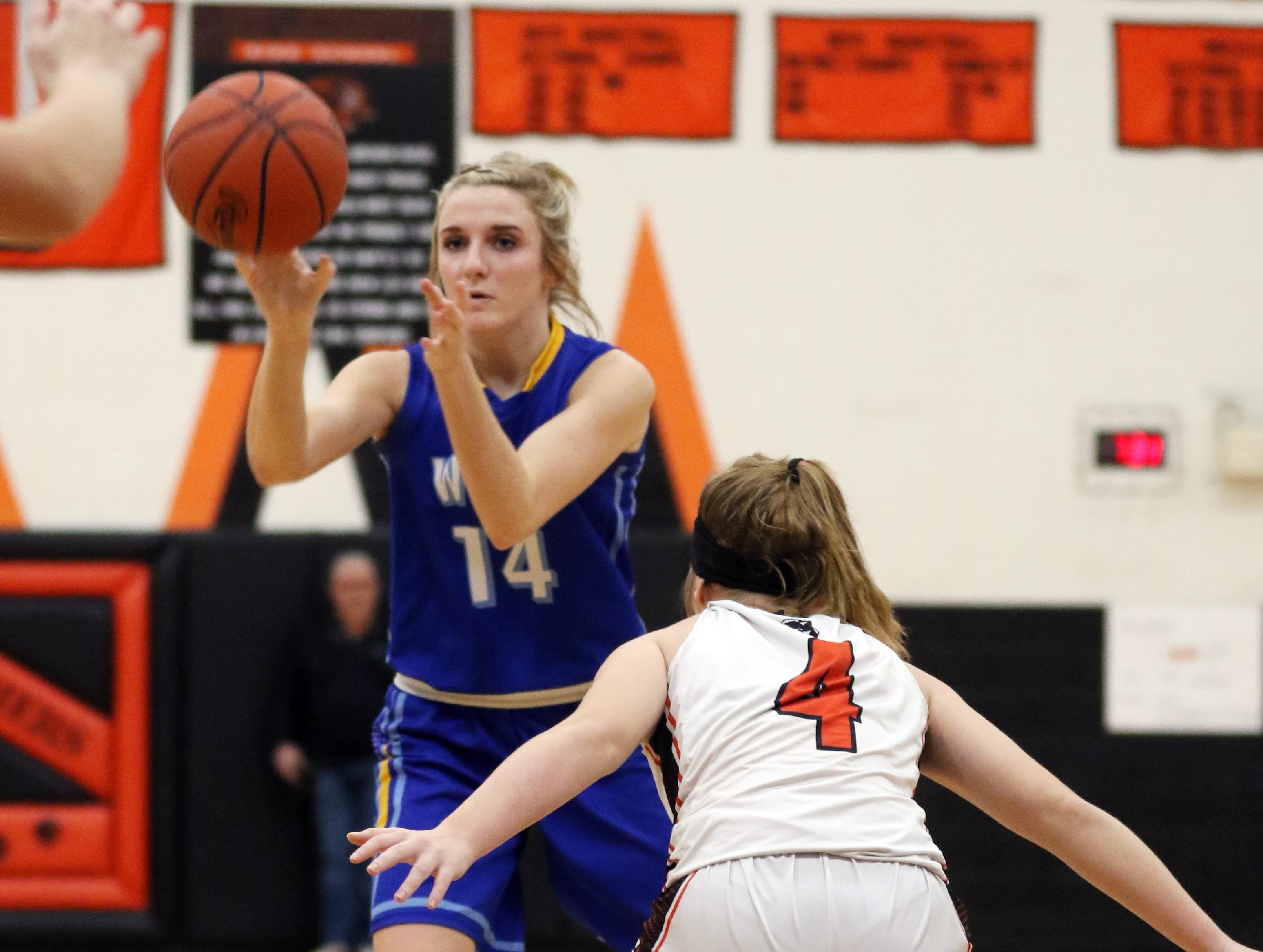 West Muskingum's Hayley Barker passes the ball against New Lexington.
