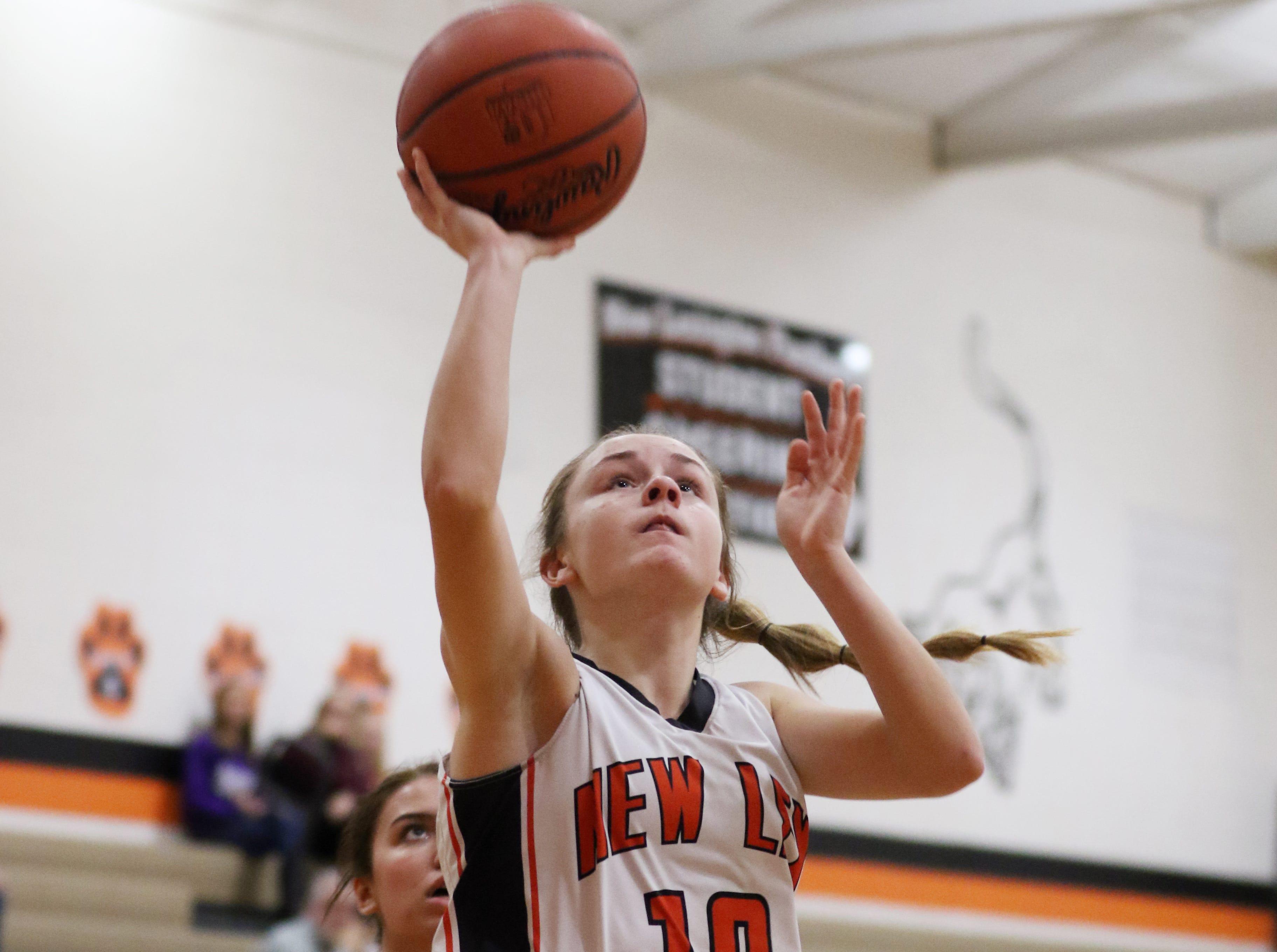 New Lexington's Emma Abrams puts up a shot against West Muskingum.