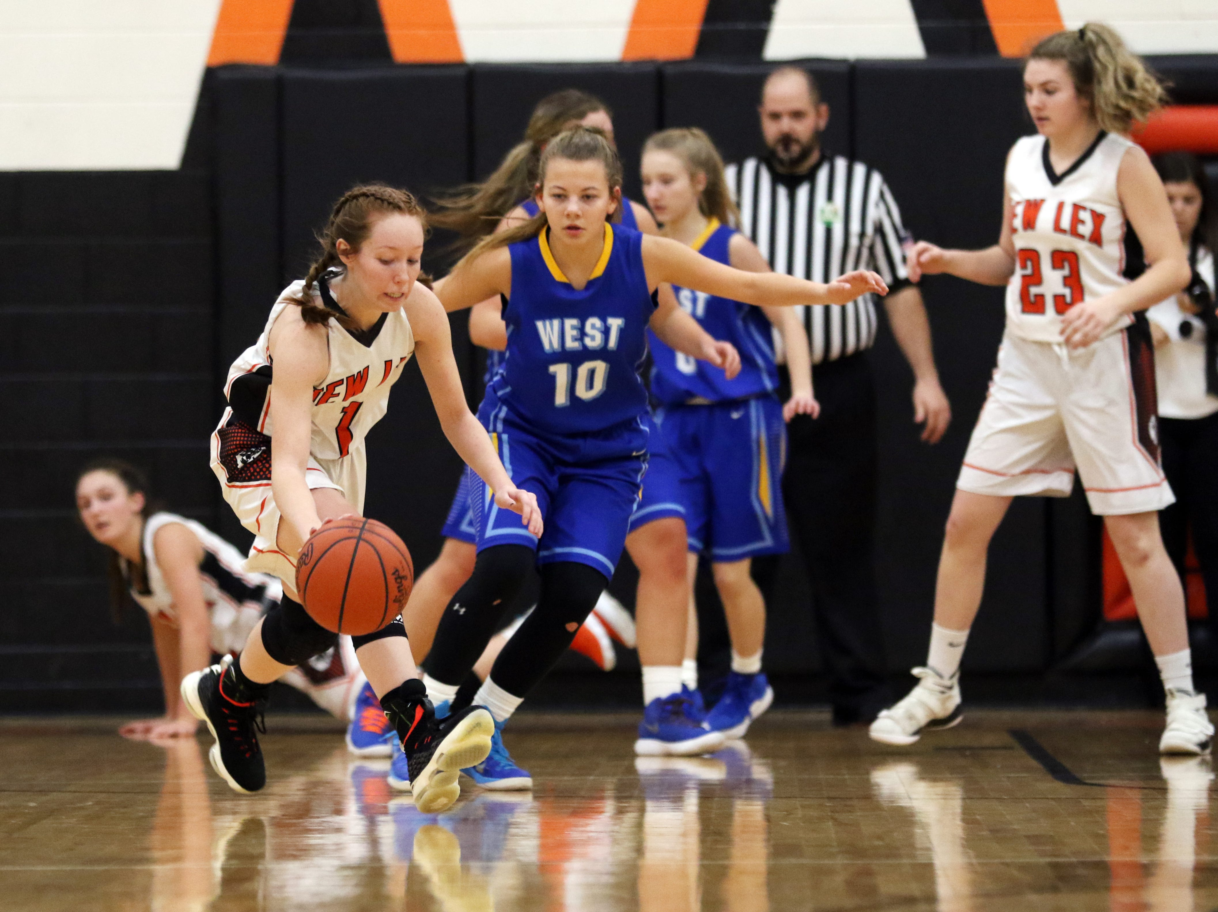 New Lexington's Kenadee Dillon moves with the ball against West Muskingum.