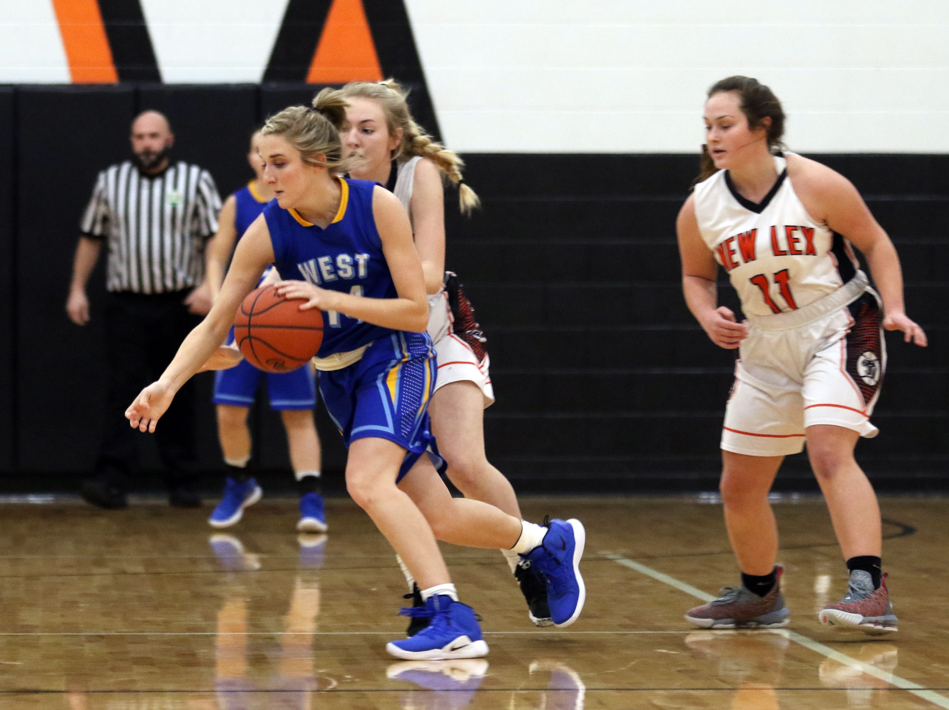 West Muskingum's Hayley Barker moves with the ball against New Lexington.