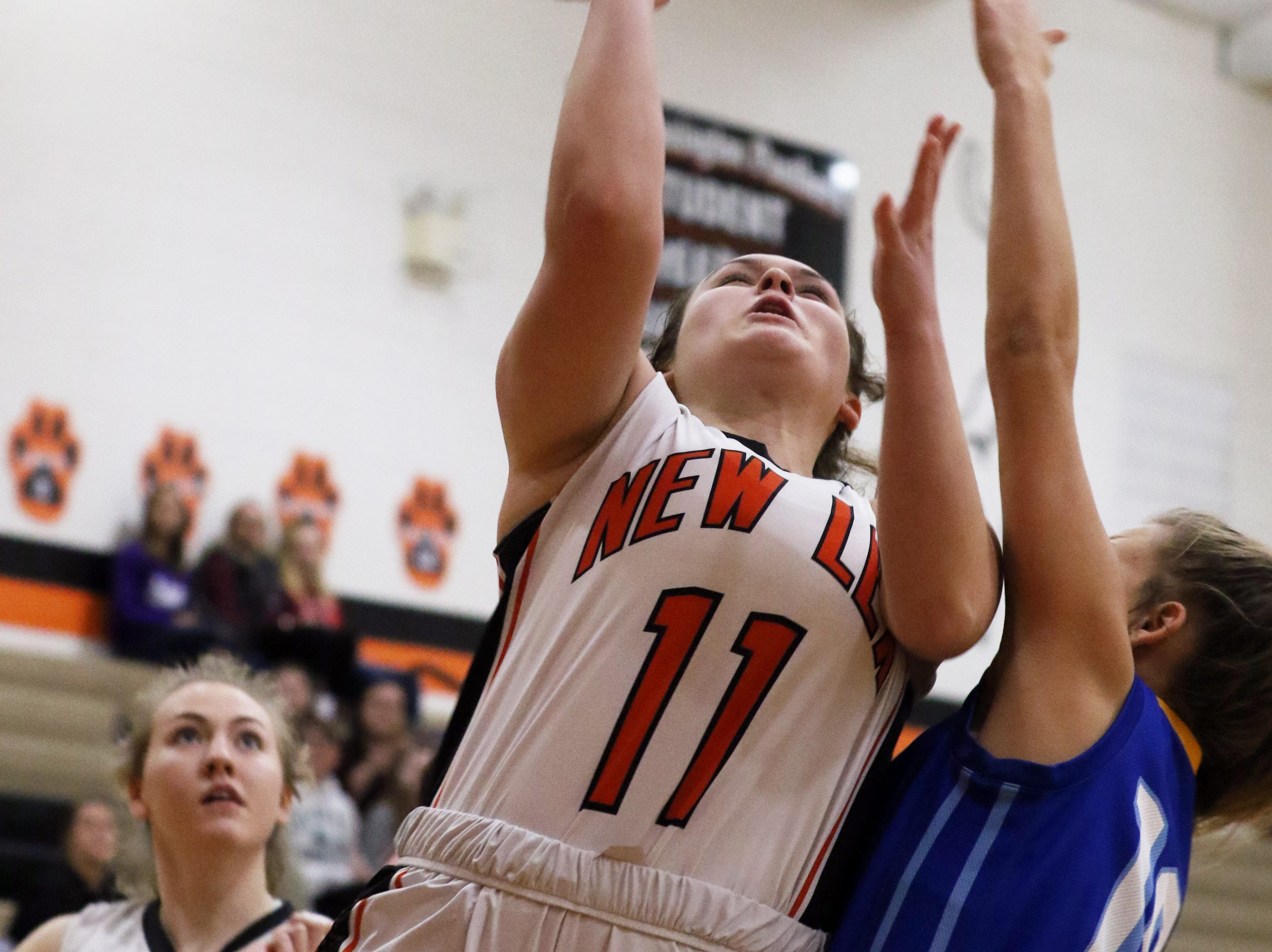 New Lexington's Haleigh Sammons puts up a shot against West Muskingum.