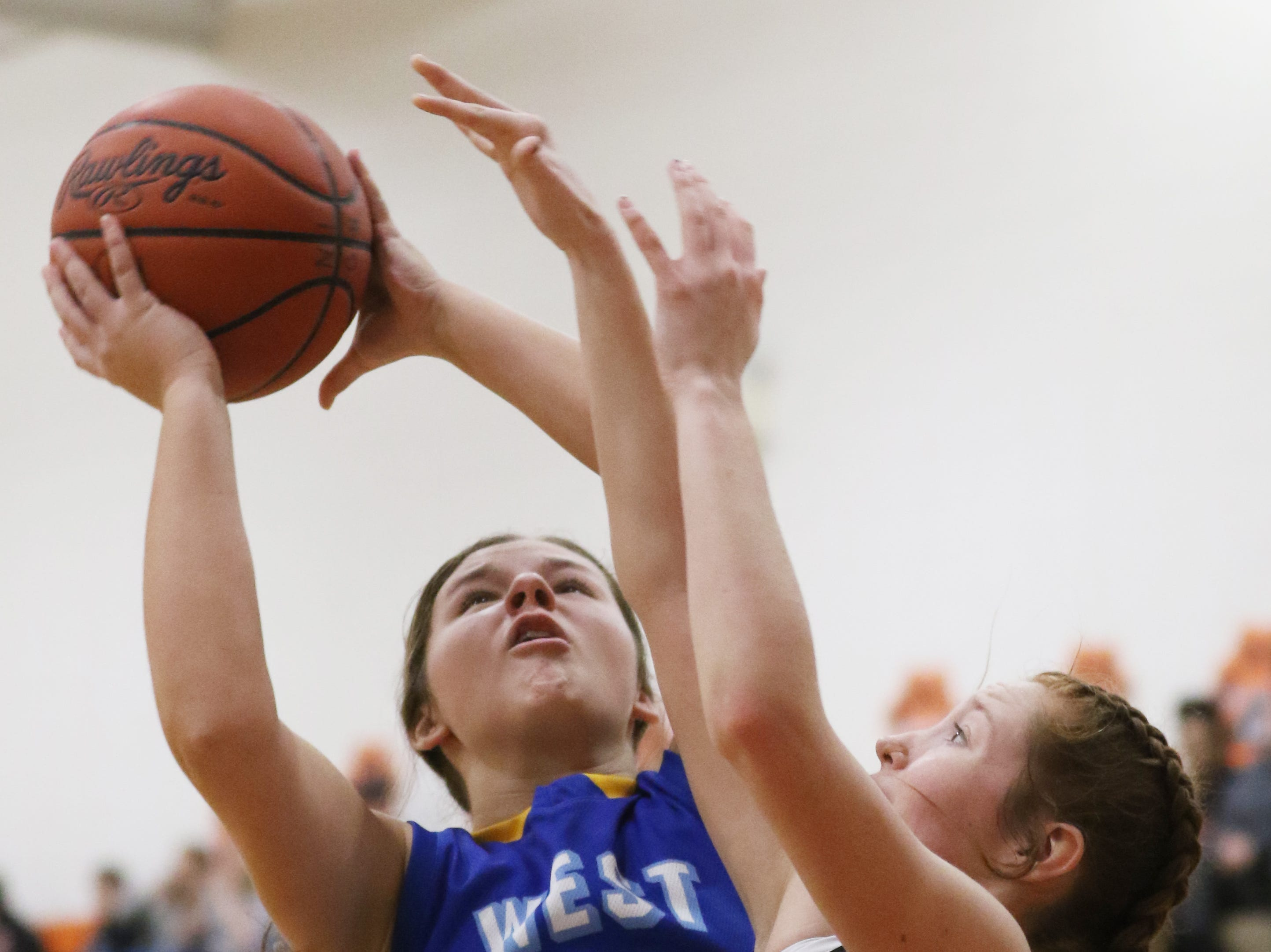 West Muskingum's Laklyn Upvall pulls down a rebound against New Lexington.