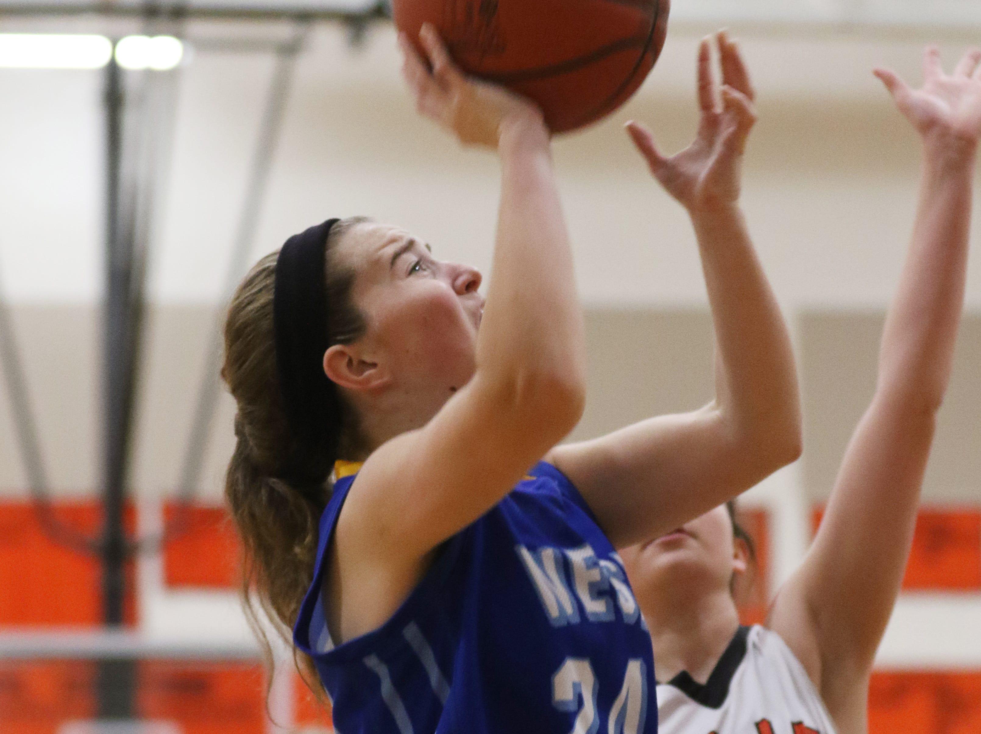West Muskingum's Lauren Weingarth puts up a shot against New Lexington.