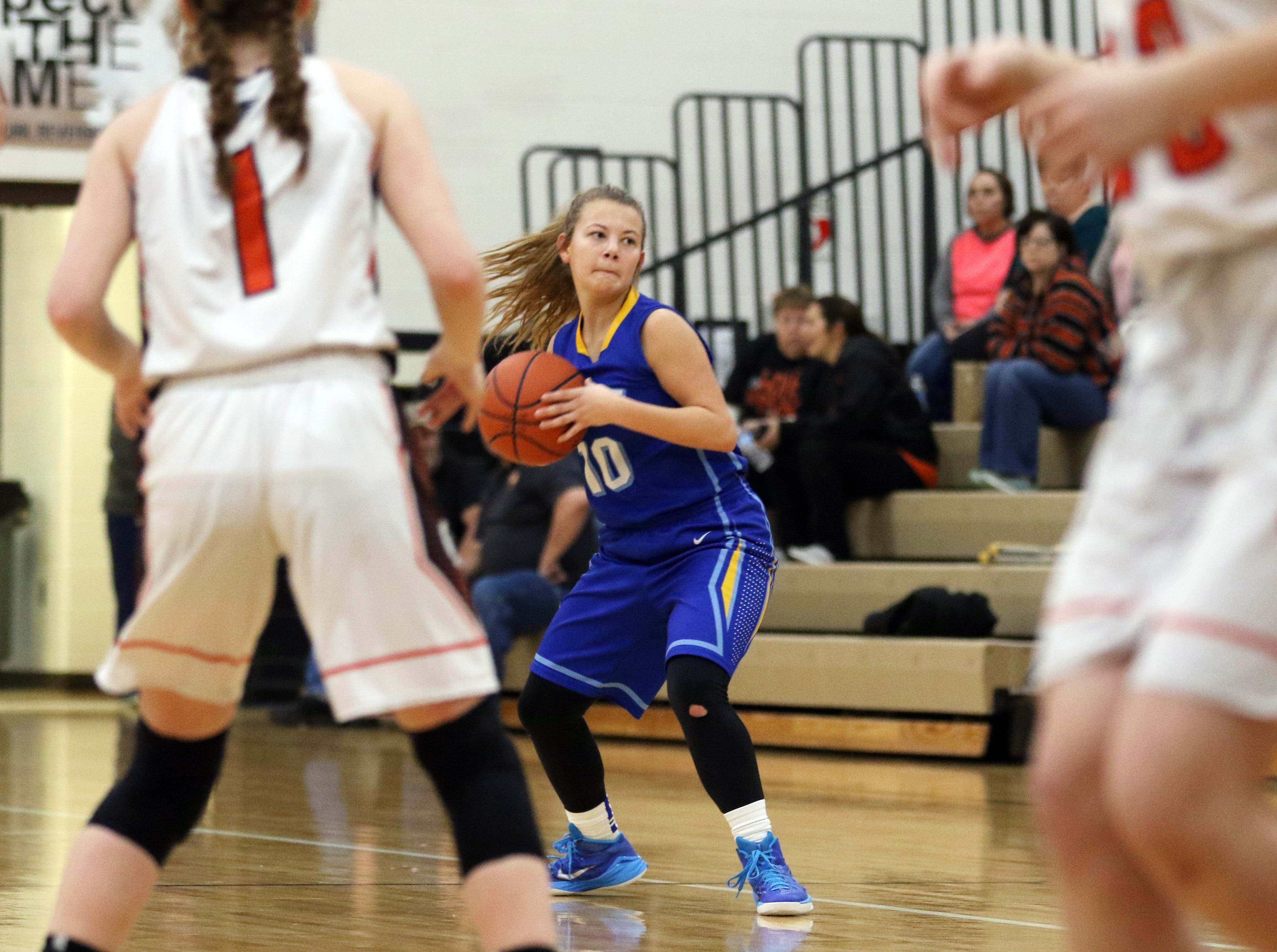 West Muskingum's Emma Abrams looks to pass against New Lexington.