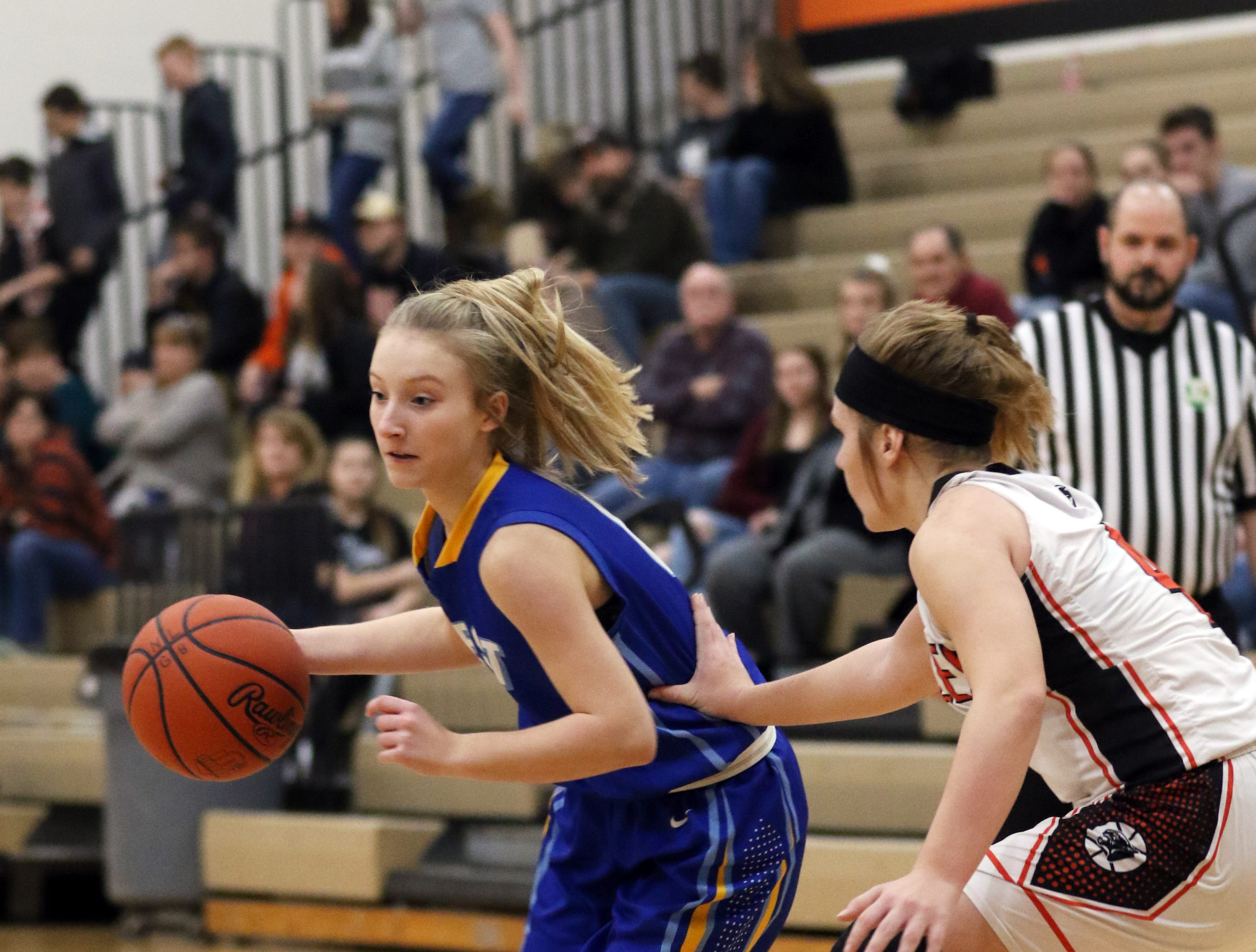 A Tornado moves with the ball against New Lexington.