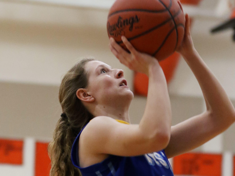 West Muskingum's Olivia Thomas puts up a shot against New Lexington.