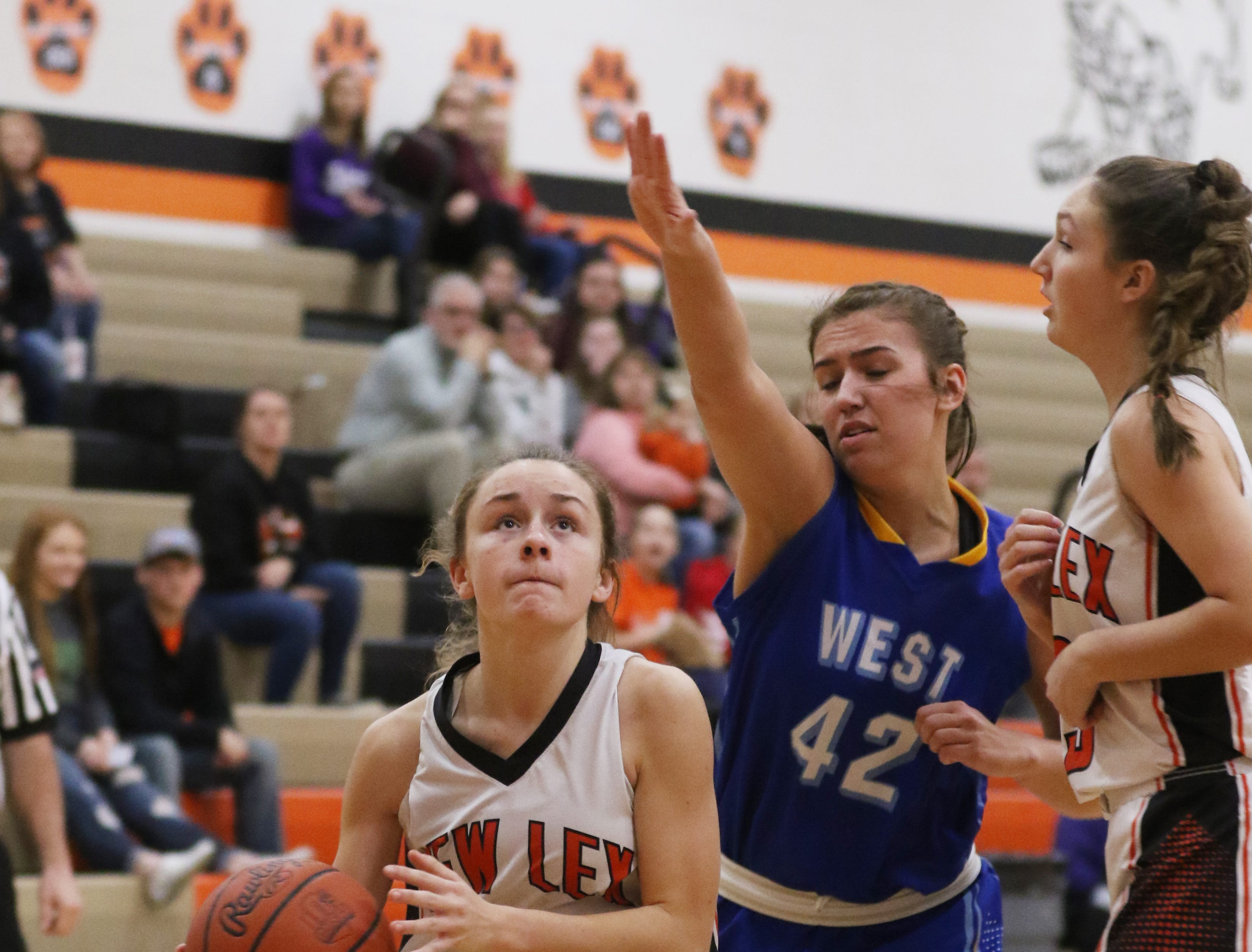 New Lexington's Emma Abrams drives to the hoop against West Muskingum.