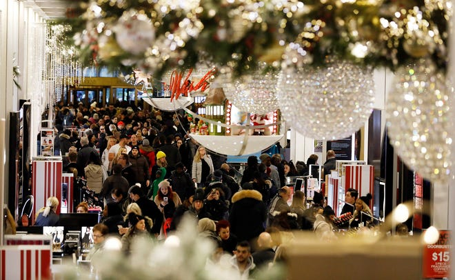 Bargain hunters seek low price deals during 'Black Friday' holiday shopping in MACY'S Herald Square in New York, New York, USA, 23 November 2018.  Black Friday is the day after the USA  Thanksgiving Day and is regarded as the start of the Christmas shopping season.