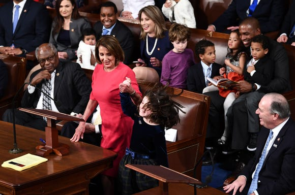Incoming House Speaker Nancy Pelosi (D-CA) and her granddaughter attend the opening session of the 116th Congress at the US Capitol in Washington, DC, January 3, 2019.