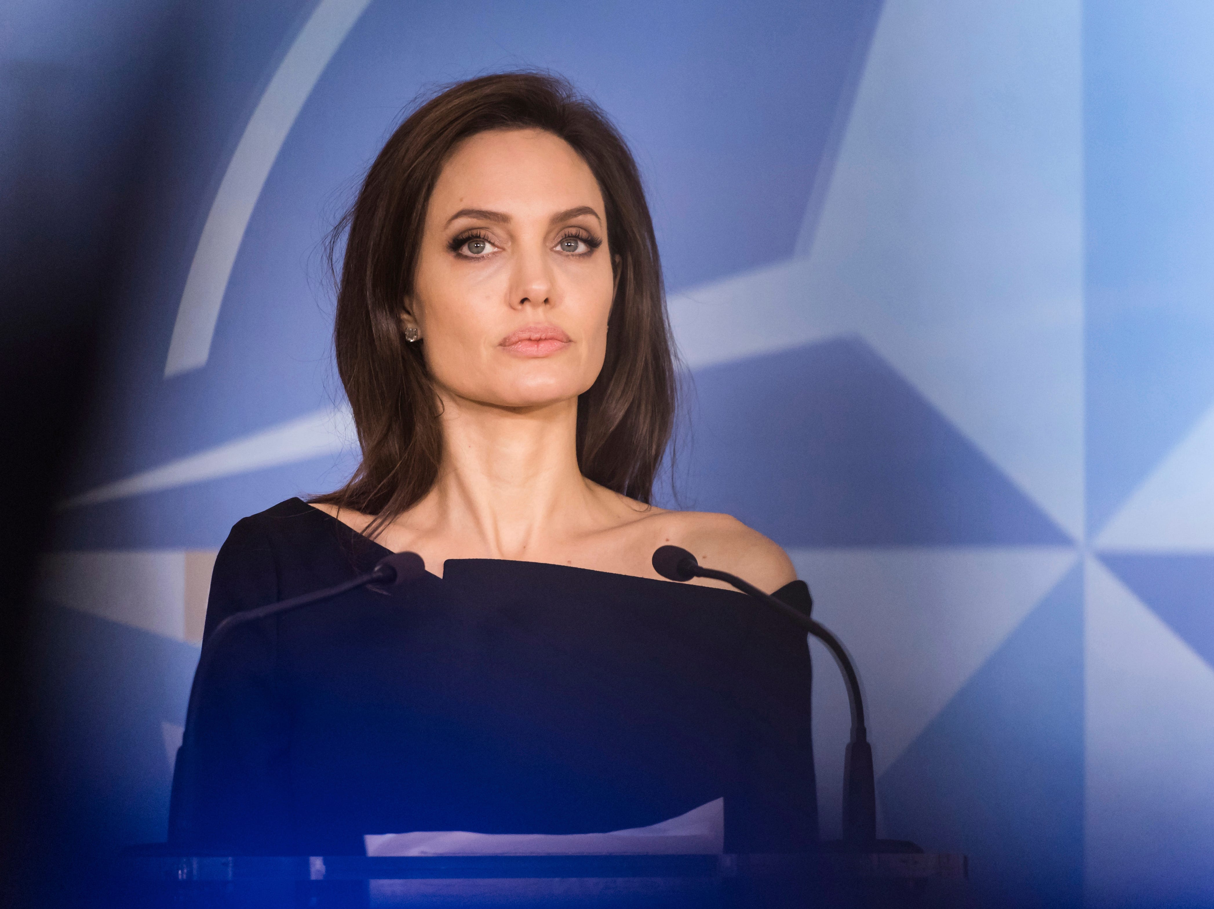 FILE - In this file photo dated Wednesday, Jan. 31, 2018, Special Envoy for the United Nations High Commissioner for Refugees Angelina Jolie addresses the media at NATO headquarters in Brussels.  American actress Jolie has not ruled out a move into politics, during an interview on BBC radio Friday Dec. 28, 2018, and has joked that she might be tough enough to take the rough and tumble that comes with it. (AP Photo/Geert Vanden Wijngaert, FILE) ORG XMIT: LON101