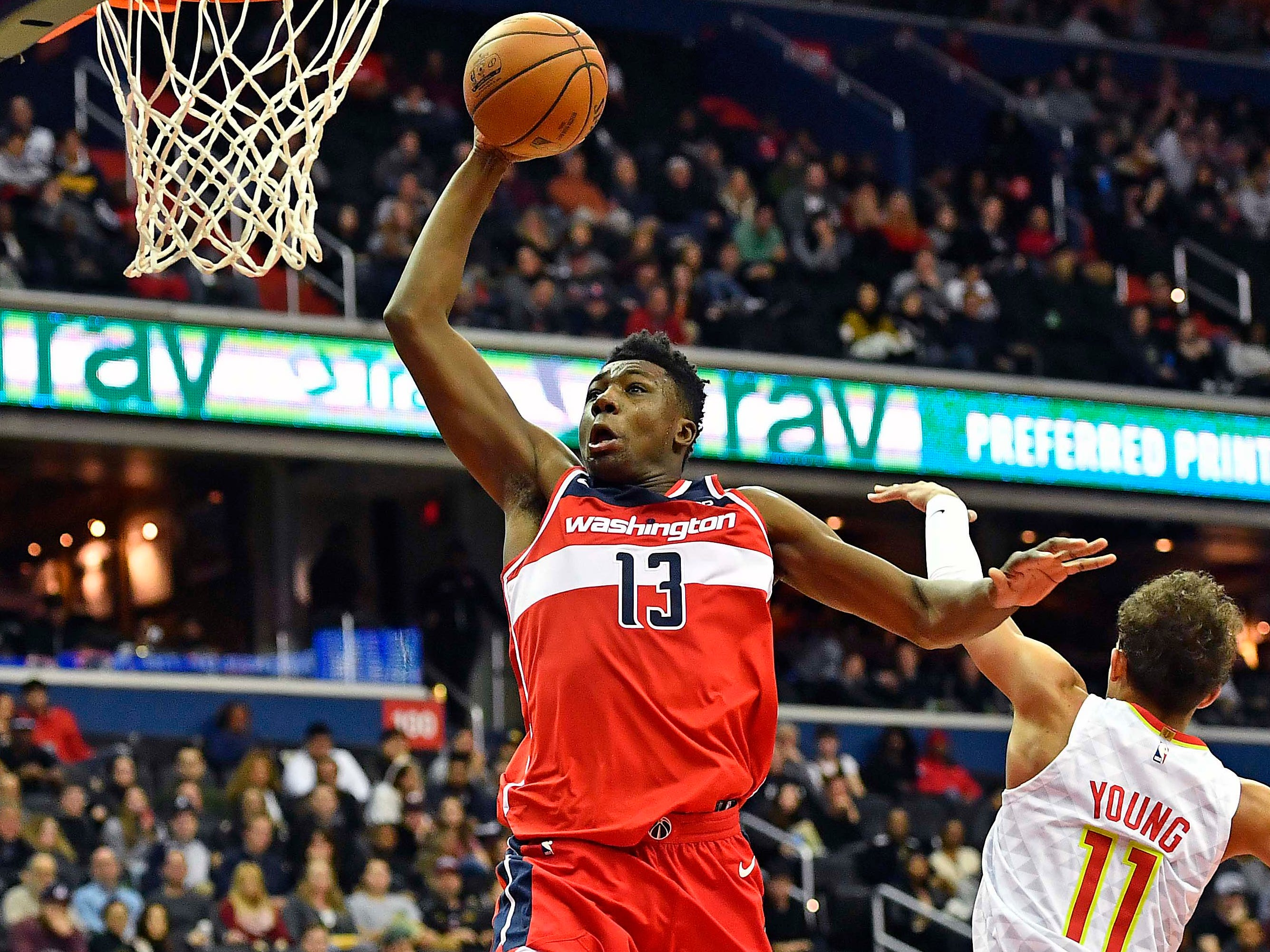 Jan. 2: Wizards center Thomas Bryant (13) soars past Hawks guard Trae Young (11) for the one-handed flush.