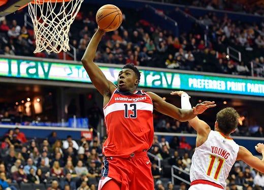 4b5d037a3e1 Jan. 2  Wizards center Thomas Bryant (13) soars past Hawks guard Trae