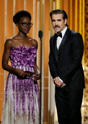 Lupita Nyong'o and Colin Farrell present during the 72nd Golden Globes.