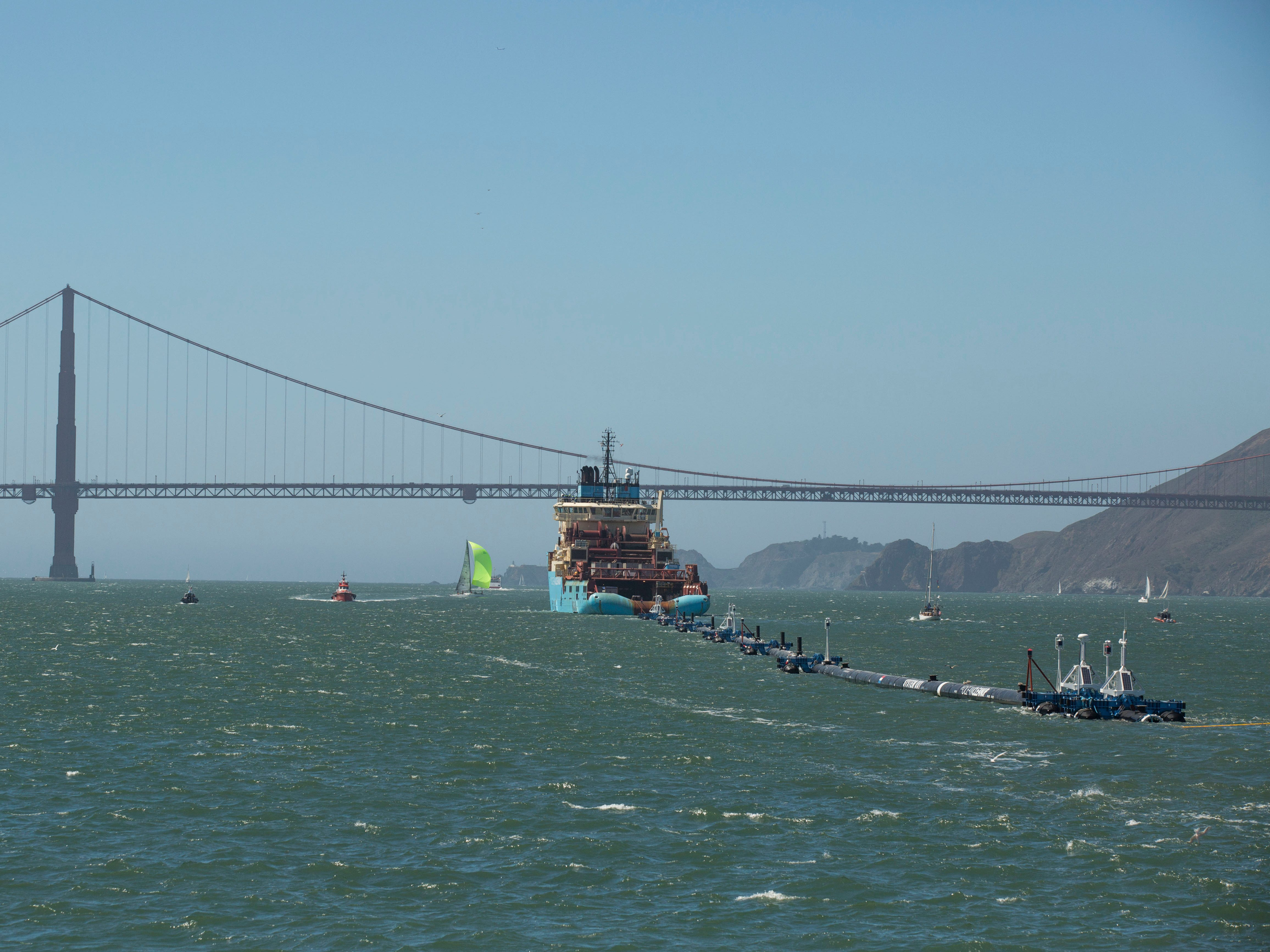 The Ocean Cleanup project, an ocean cleaning system, moves through the San Francisco Bay as it heads towards the Pacific Ocean for testing on Sept. 8. 2018. The project is the expensive, untried brainchild of a 24-year-old Dutch college dropout named Boyan Slat, who was so disgusted by the plastic waste he encountered diving off Greece as a teen that he has devoted his life to cleaning up the mess. If the test is successful, the Ocean Cleanup project will be moved to the Great Pacific Garbage Patch.