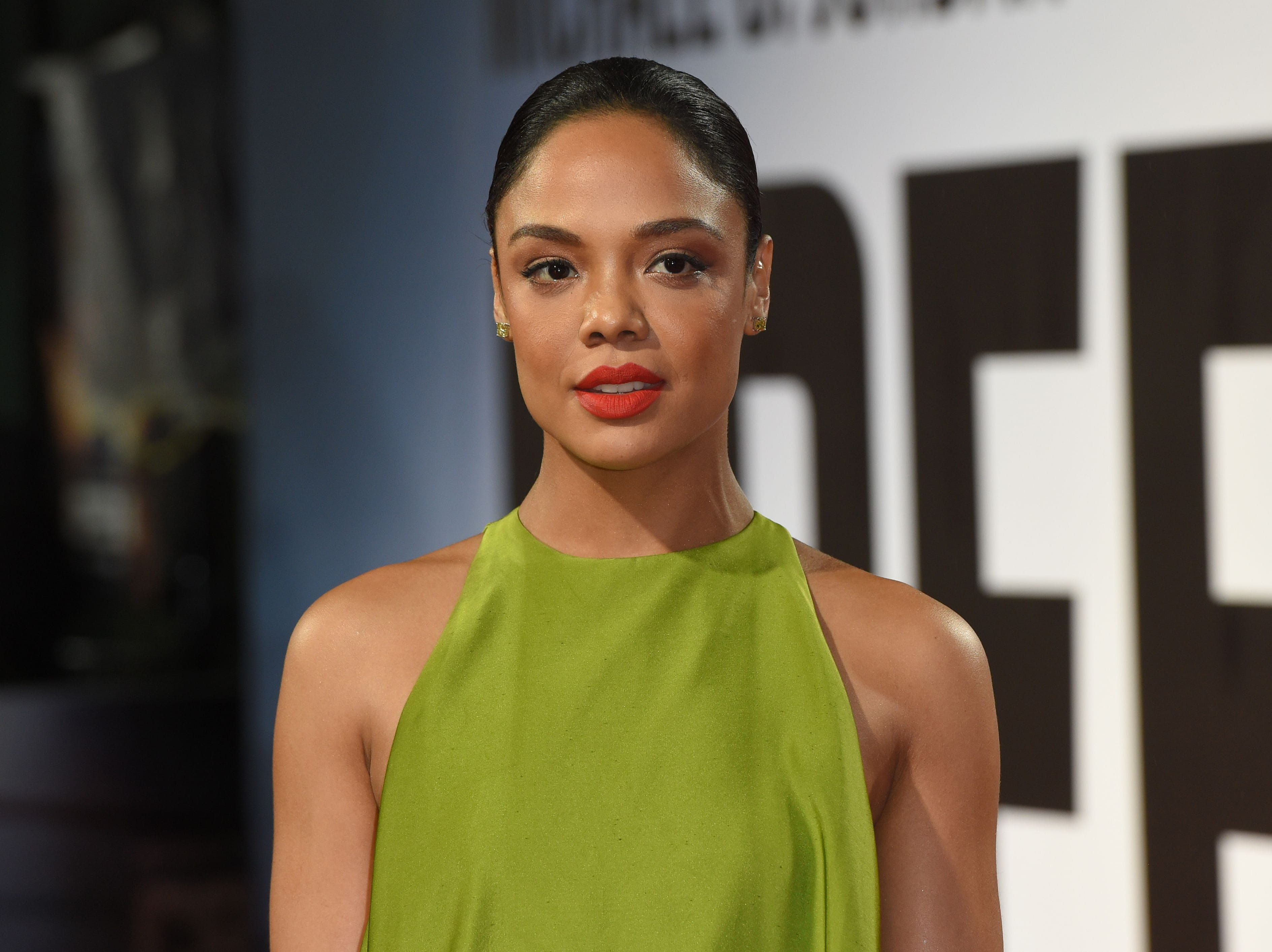 """US actor Tessa Thompson poses upon arrival to attend the European Premiere of the film """"Creed II"""" in London on November 28, 2018. (Photo by Anthony HARVEY / AFP)ANTHONY HARVEY/AFP/Getty Images ORIG FILE ID: AFP_1B679H"""