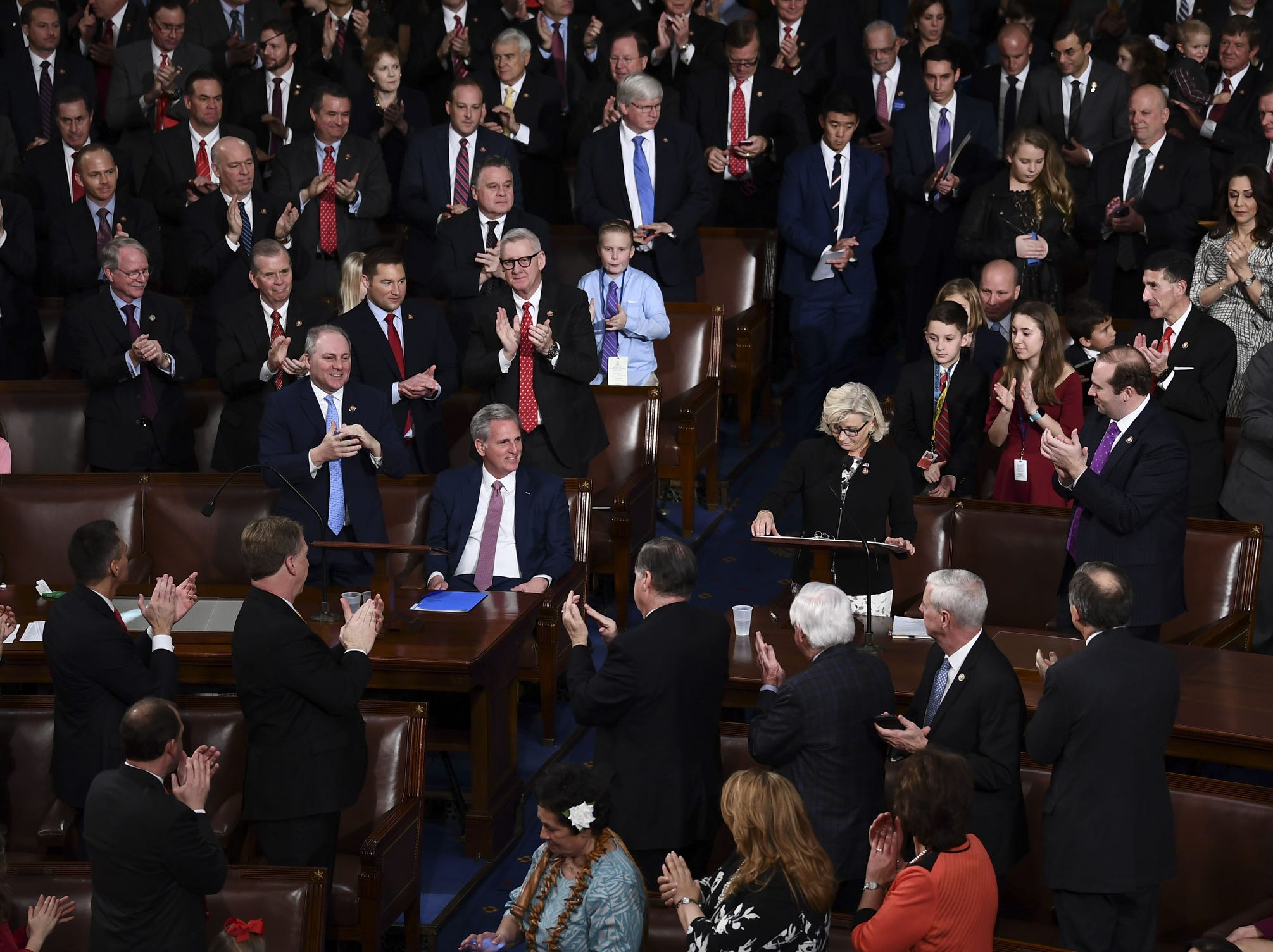 Liz Cheney, right,  incoming GOP House Conference chairwoman speaks at the start of the 116th Congress and swearing-in ceremony on the floor of the US House of Representatives at the US Capitol.