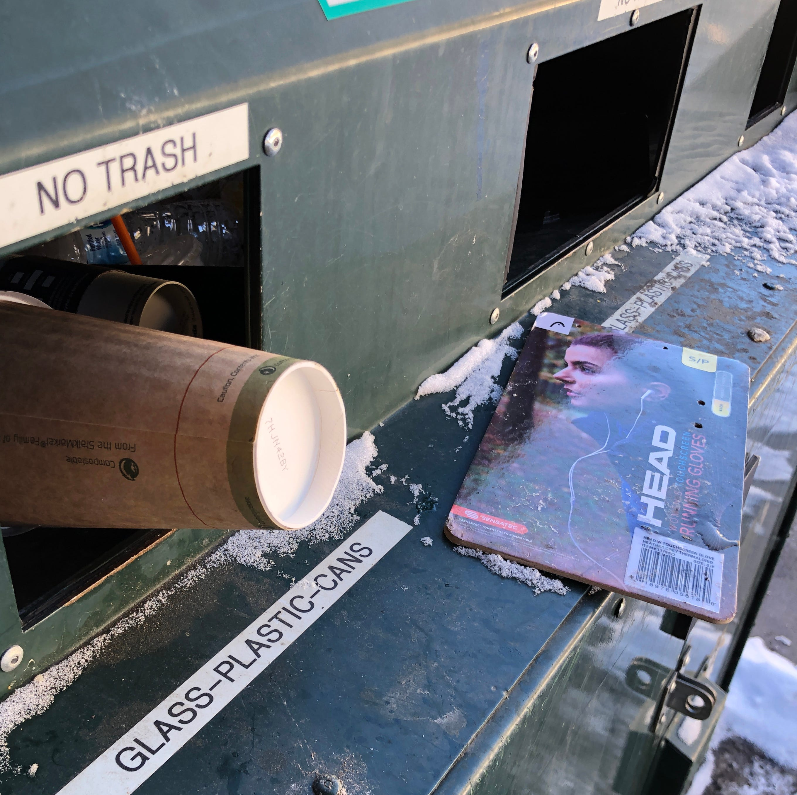 Trash hangs out of an overflowing recycling bin near the visitor's center at Rocky Mountain National Park in Colorado.