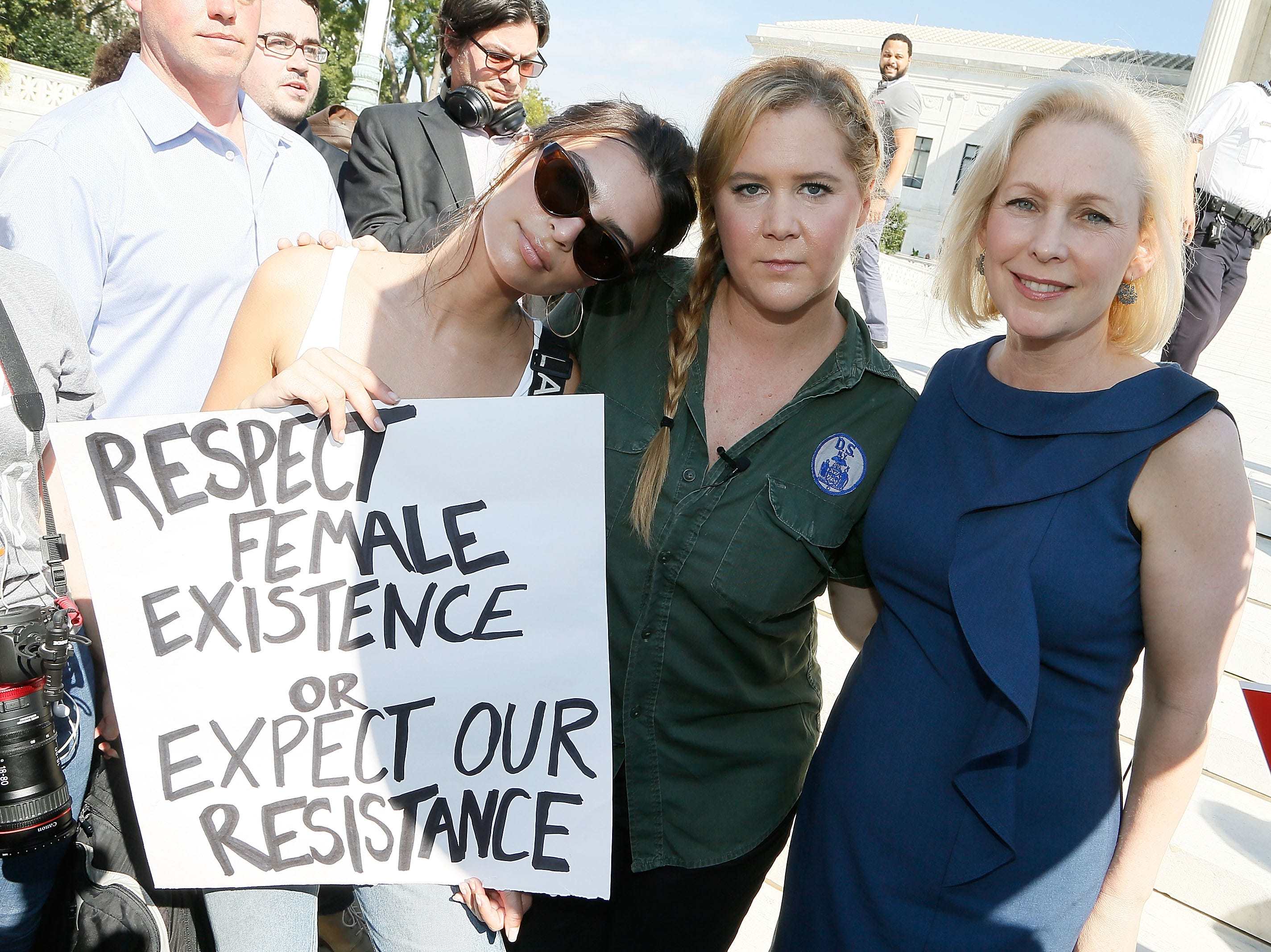 WASHINGTON, DC - OCTOBER 04:  (L to R) Model and actress Emily Ratajkowski; actress and comedian Amy Schumer; and  Sen. Kirsten Gillibrand (D-NY) join the Brett Kavanaugh U.S. Supreme Court Confirmation Protest in front of the Supreme Court on October 4, 2018 in Washington, DC.  (Photo by Paul Morigi/WireImage) ORG XMIT: 775237808 ORIG FILE ID: 1045666158
