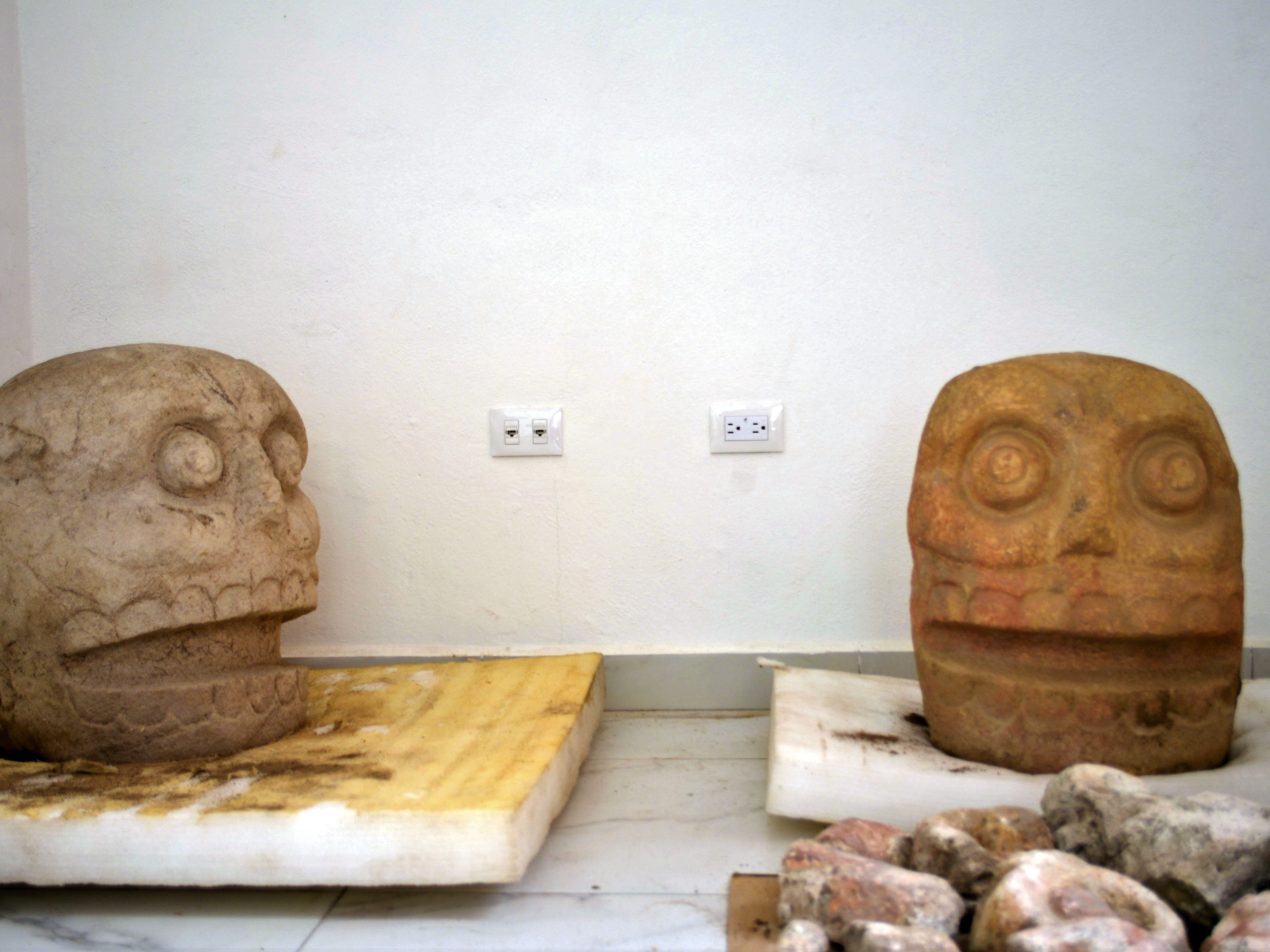 Handout picture released by Mexico's National Institute of Anthropology and History (INAH) taken on October 12, 2018 showing two sculptures dedicated to the pre-Hispanic fertility god Xipe Totec (The Flayed Lord), found at the first temple recently discovered of the deity in the archaeological site of Ndachjian-Tehuacan, in the Mexican state of Puebla.