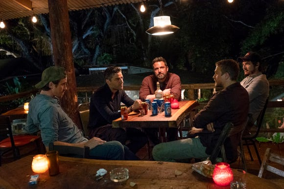 "Former Special Forces operatives (Garrett Hedlund, from left, Oscar Isaac, Ben Affleck, Charlie Hunnam and Pedro Pascal) plan a daring South American heist in Netflix's ""Triple Frontier."""
