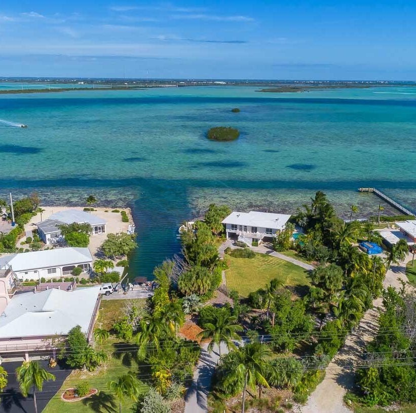 This $1.5 million property on Sugarloaf Key sits on one acre with waterfront views on two sides.