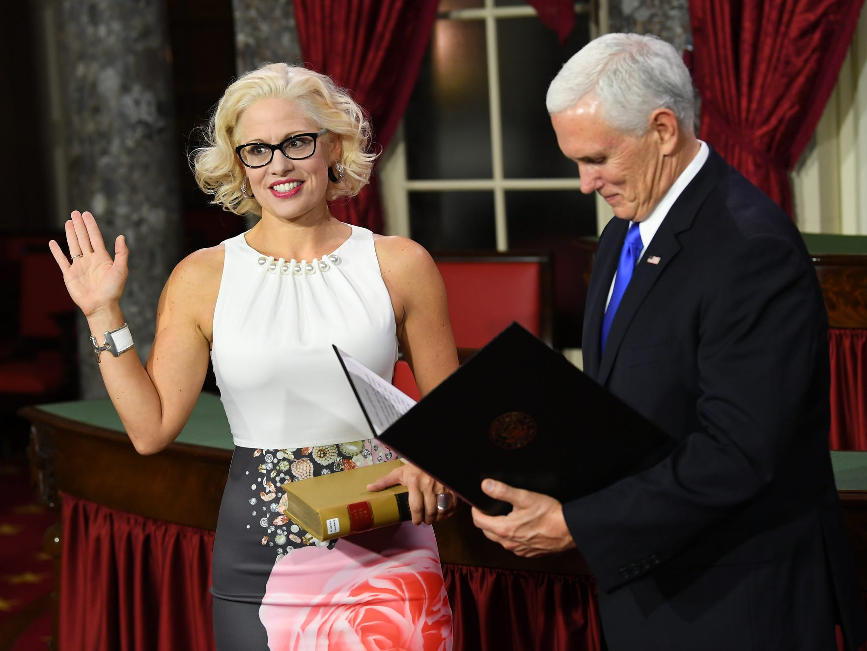 Vice President Mike Pence officiates ceremonial swearing of Senator Kyrsten Sinema (D-AZ).