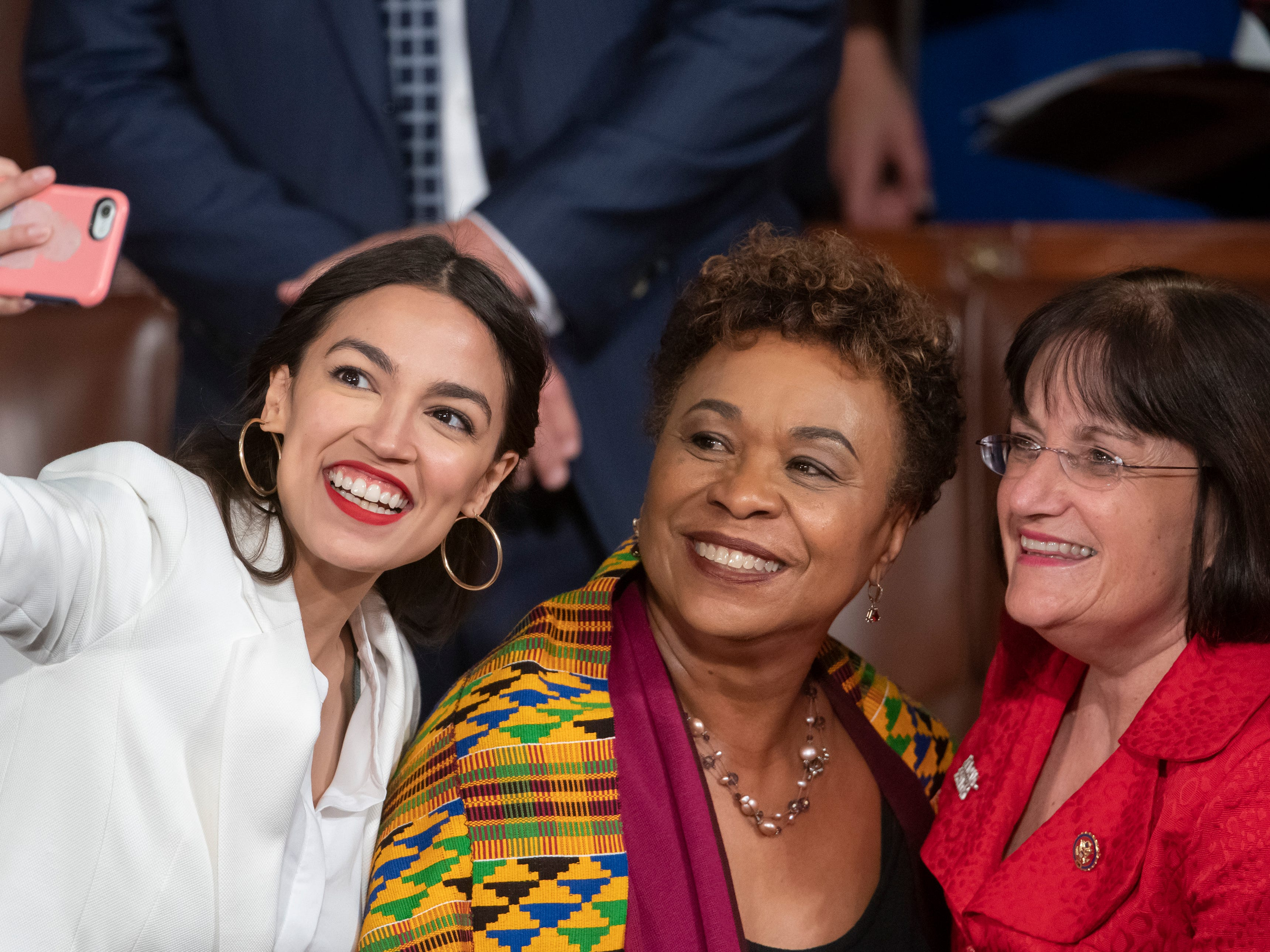 Rep.-elect Alexandria Ocasio-Cortez, a freshman Democrat representing New York's 14th Congressional District, takes a selfie with Rep. Ann McLane Kuster, D-NH, and Rep. Barbara Lee, D-Calif., on the first day of the 116th Congress with Democrats holding the majority, at the Capitol in Washington, Thursday,  Jan. 3, 2019. (AP Photo/J. Scott Applewhite) ORG XMIT: DCSA105