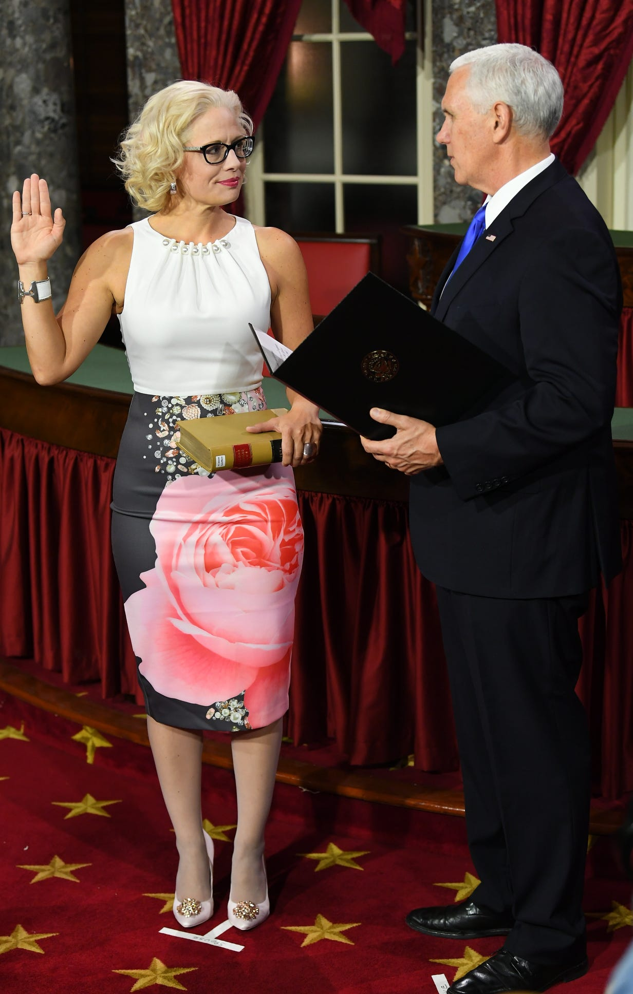 Senator Kyrsten Sinema (D-AZ) is the first openly bisexual candidate elected to the Sentate.  She chose to hold a law book for her swearing in, Thursday.