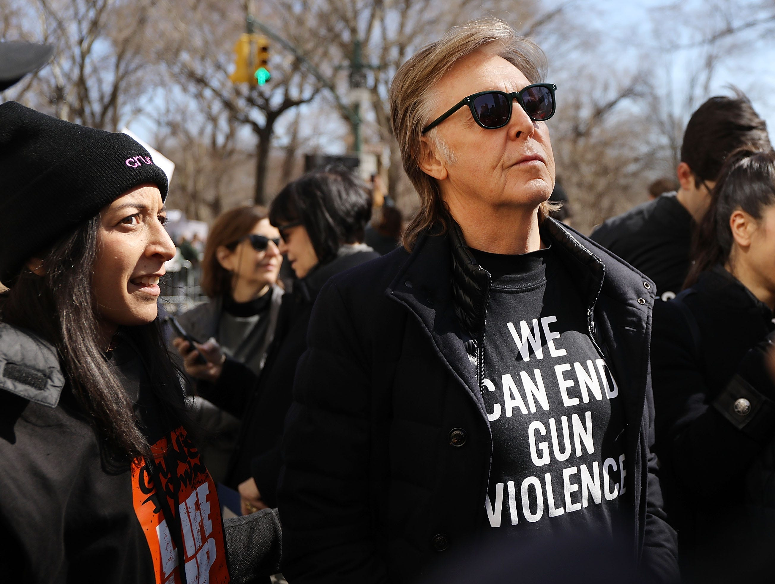 NEW YORK, NY - MARCH 24:  Sir Paul McCartney joins thousands of people, many of them students, march against gun violence in Manhattan during the March for Our Lives rally on March 24, 2018 in New York, United States. More than 800 March for Our Lives events, organized by survivors of the Parkland, Florida school shooting on February 14 that left 17 dead, are taking place around the world to call for legislative action to address school safety and gun violence.  (Photo by Spencer Platt/Getty Images) ORG XMIT: 775145471 ORIG FILE ID: 937355656