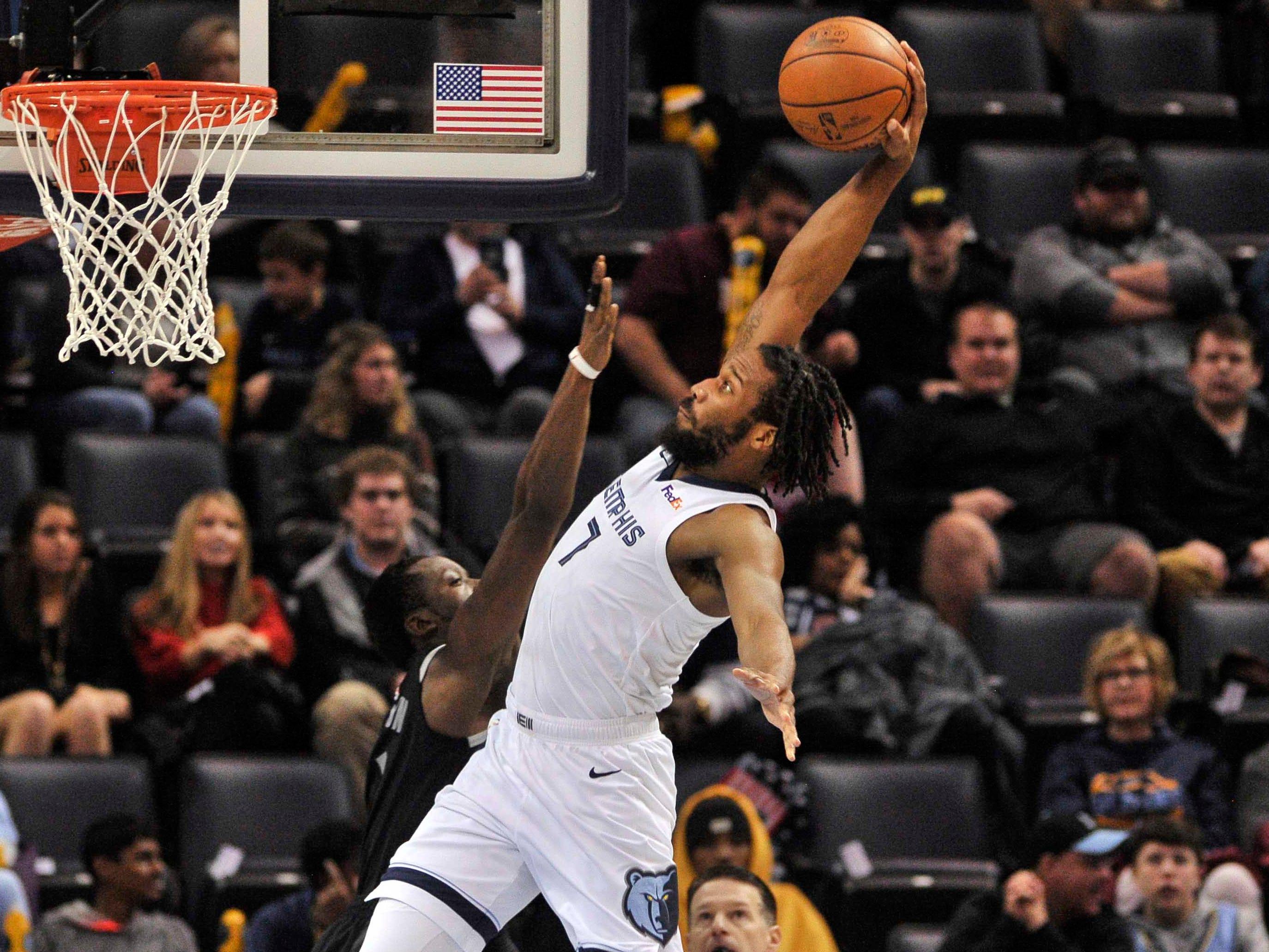 Jan. 2: Grizzlies guard Wayne Selden (7) hammers it home with authority over Pistons defender Reggie Jackson (1).