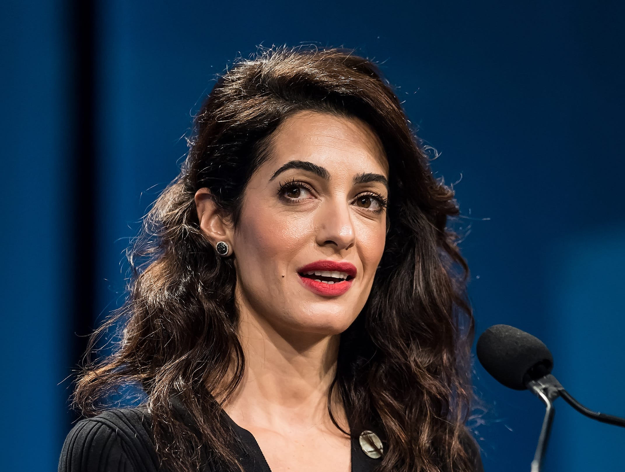PHILADELPHIA, PA - OCTOBER 12:  Human rights lawyer and specialising in international law Amal Clooney delivers her Keynote Speech on stage during Pennsylvania Conference for Women 2018 at Pennsylvania Convention Center on October 12, 2018 in Philadelphia, Pennsylvania.  (Photo by Gilbert Carrasquillo/WireImage) ORG XMIT: 775241661 ORIG FILE ID: 1051972694