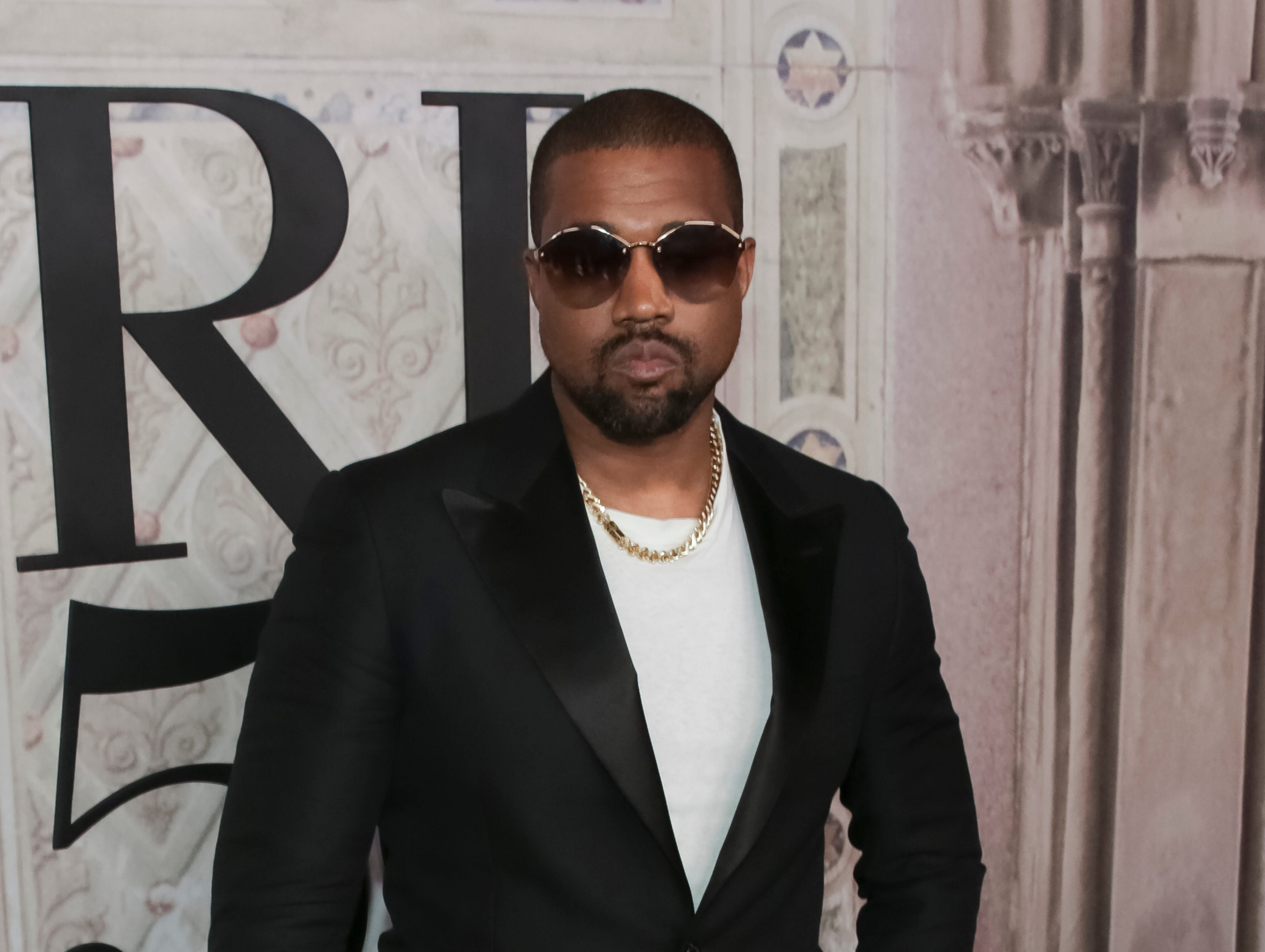 FILE - In this Sept. 7, 2018, file photo, Kanye West attends the Ralph Lauren 50th Anniversary Event held at Bethesda Terrace in Central Park during New York Fashion Week in New York.  West appeared to reignite a feud with the fellow rapper in a series of tweets on Thursday, Dec. 13, 2018,  in which he claimed Drake had called trying to threaten him.   (Photo by Brent N. Clarke/Invision/AP, File) ORG XMIT: NY107