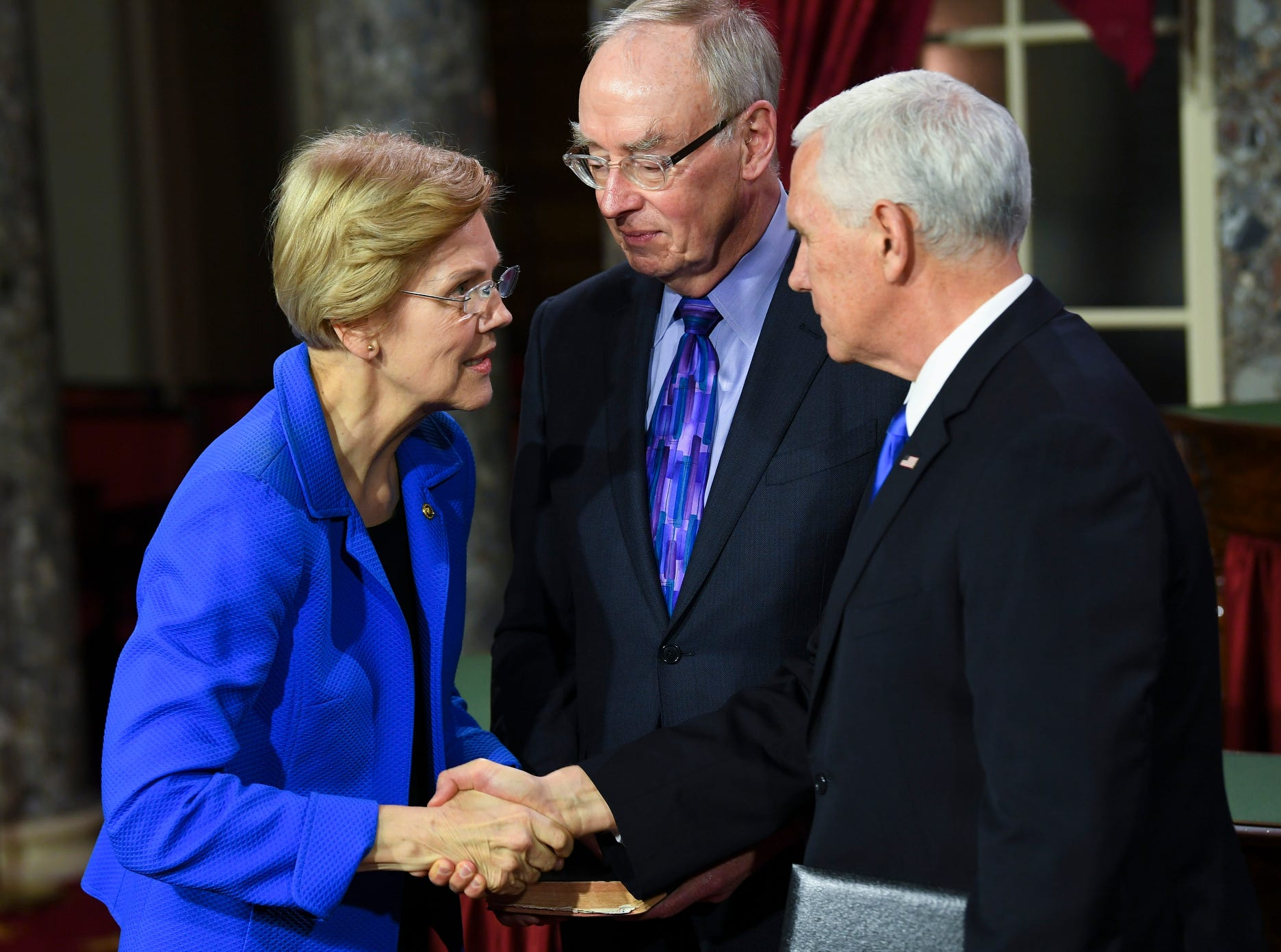 Vice President Pence speaking with Senator Elizabeth Warren (D-MA) after he officiated ceremonial swearing of Senator Warren in the Old Senate Chambers at the U.S. Capitol.