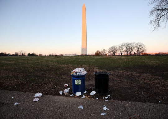 Trash builds up along the National Mall as trash collectors are off work during a partial shutdown of the federal government, on December 23, 2018 in Washington, DC. Mayor Muriel Bowser said the City will help with trash pickup while the National Park Service is closed.