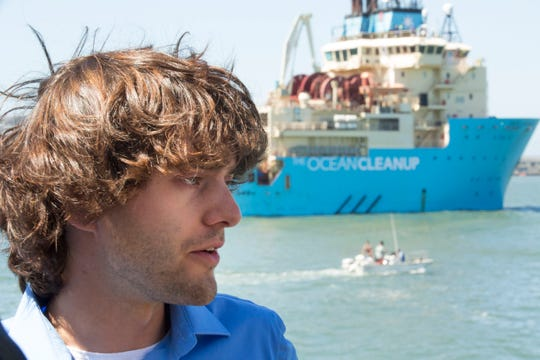 Boyan Slat watches as The Ocean Cleanup project, an ocean cleaning system, moves through the San Francisco Bay as it moves towards the Pacific Ocean for testing on Sept. 8. 2018.