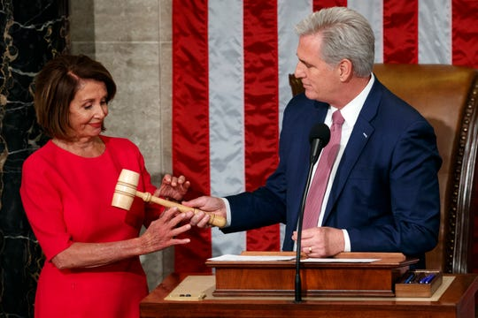 Nancy Pelosi of California takes the gavel from House Minority Leader Kevin McCarthy, R-Calif., after being elected House speaker at the Capitol in Washington, Thursday, Jan. 3, 2019.
