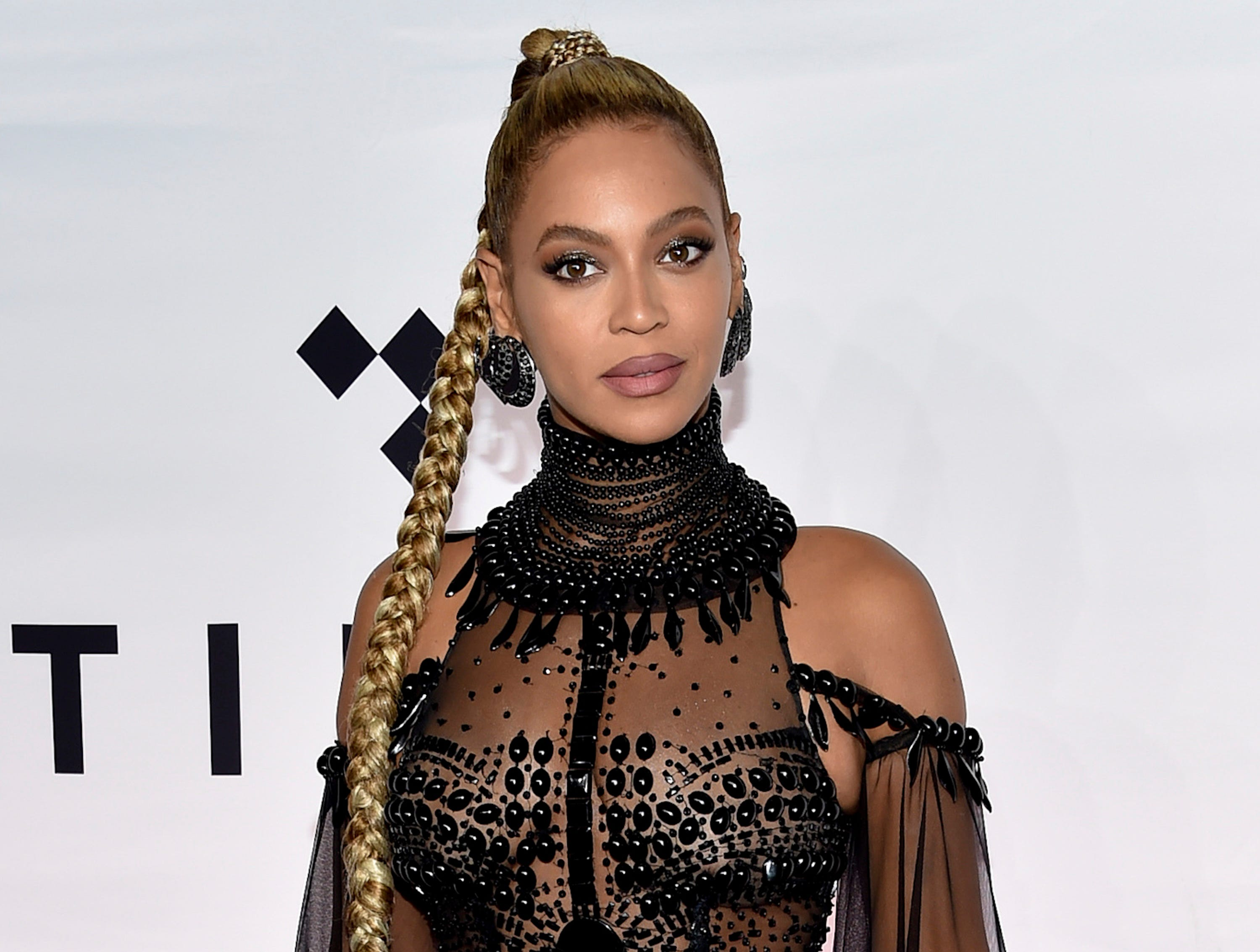 """FILE - In this Oct. 15, 2016, file photo, singer Beyonce Knowles attends the Tidal X: 1015 benefit concert in New York. Beyonce brought her star power to a pre-wedding party for the daughter of India's richest mogul. Beyonce performed Sunday, Dec. 9, 2018, and sang some of her hits such as """"Crazy In Love"""" and """"Perfect."""" Guests included Hillary Clinton and a host of Bollywood stars in the historic Indian city of Udaipur. (Photo by Evan Agostini/Invision/AP, File) ORG XMIT: NYAG102"""