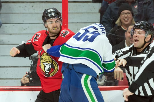 Ottawa's Ben Harpur mixes it up with the Canucks' Tim Schaller during his time with the Senators. Harpur has agreed to a one-year, two-way contract with the Predators after being traded to Nashville from Toronto on Feb. 22.