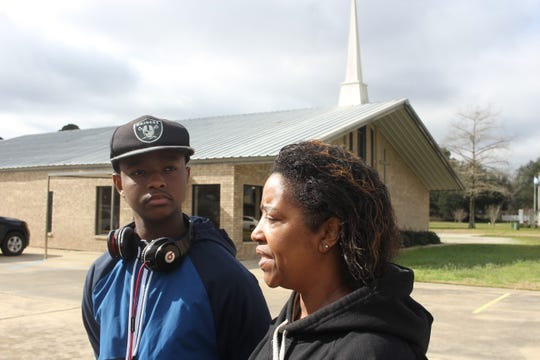 Evin Courtney, 13, and his mother, Lorraine Courtney, stand outside the Avoyelles House of Mercy in Marksville on Friday. Evin said a friend of his was one of five children who died Thursday in a fiery crash on a Florida interstate as a group from the church headed to Walt Disney World.