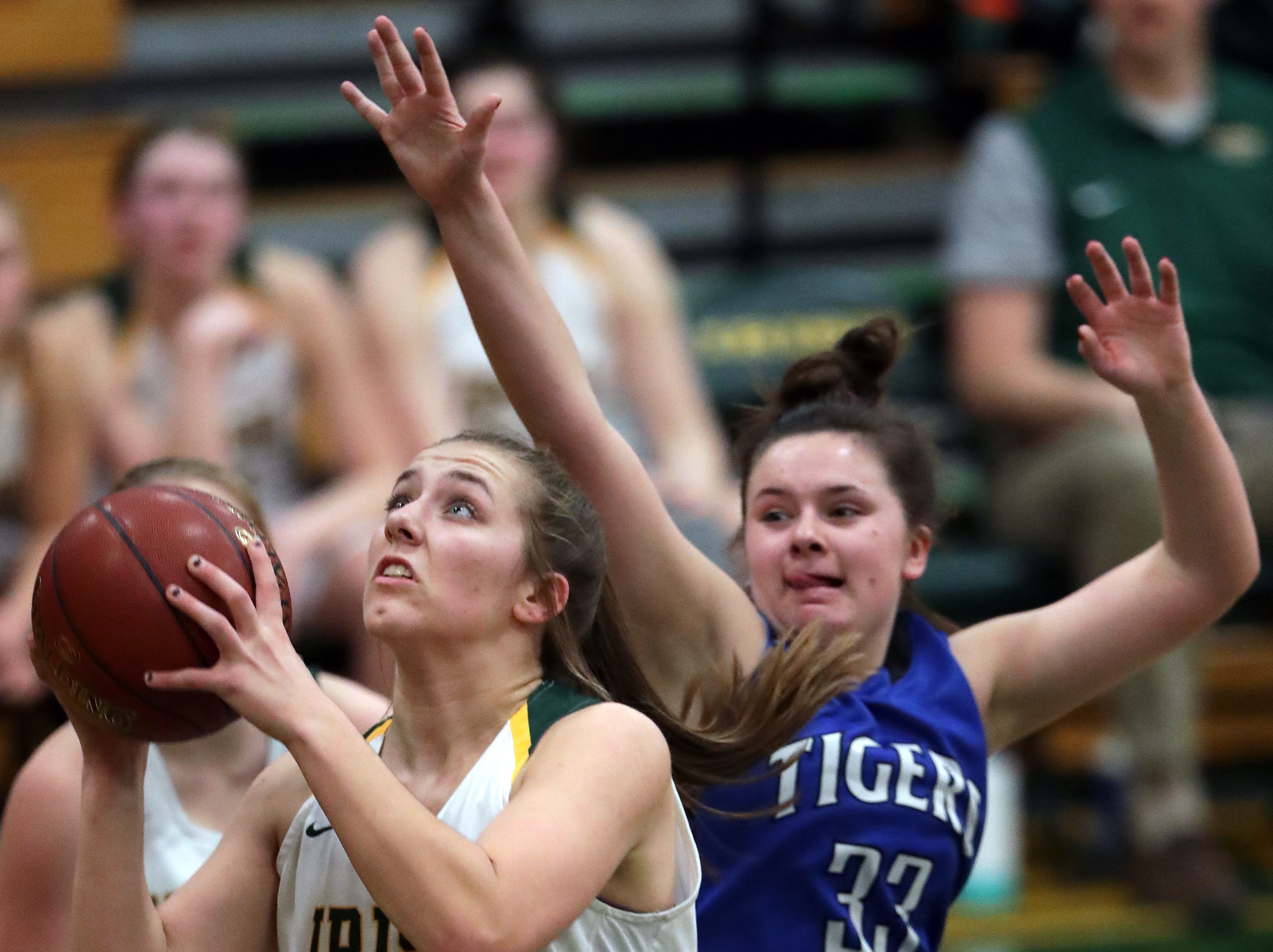 Freedom High School's #22 Taylor Haase against Wrightstown High School's #33 Dyna Van Egeren during their North Eastern Conference girls basketball game on Thursday, January 3, 2019, in Freedom, Wis. Freedom defeated Wrightstown 54 to 34.Wm. Glasheen/USA TODAY NETWORK-Wisconsin.