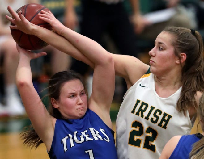 Freedom's Taylor Haase, right, defends Wrightstown's Bridget Froehlke during their game Thursday. Haase finished with 12 points and seven rebounds in Freedom's 54-34 victory.