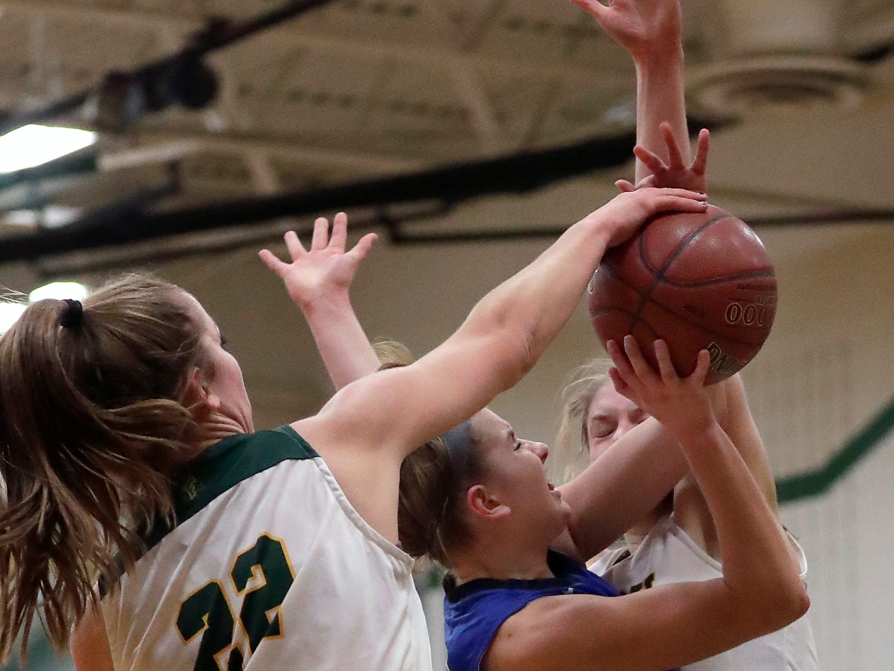 Freedom High School's #22 Taylor Haase  and #14 Karissa Wurster against Wrightstown High School's #12 Meghan Riha during their North Eastern Conference girls basketball game on Thursday, January 3, 2019, in Freedom, Wis. Freedom defeated Wrightstown 54 to 34.Wm. Glasheen/USA TODAY NETWORK-Wisconsin.