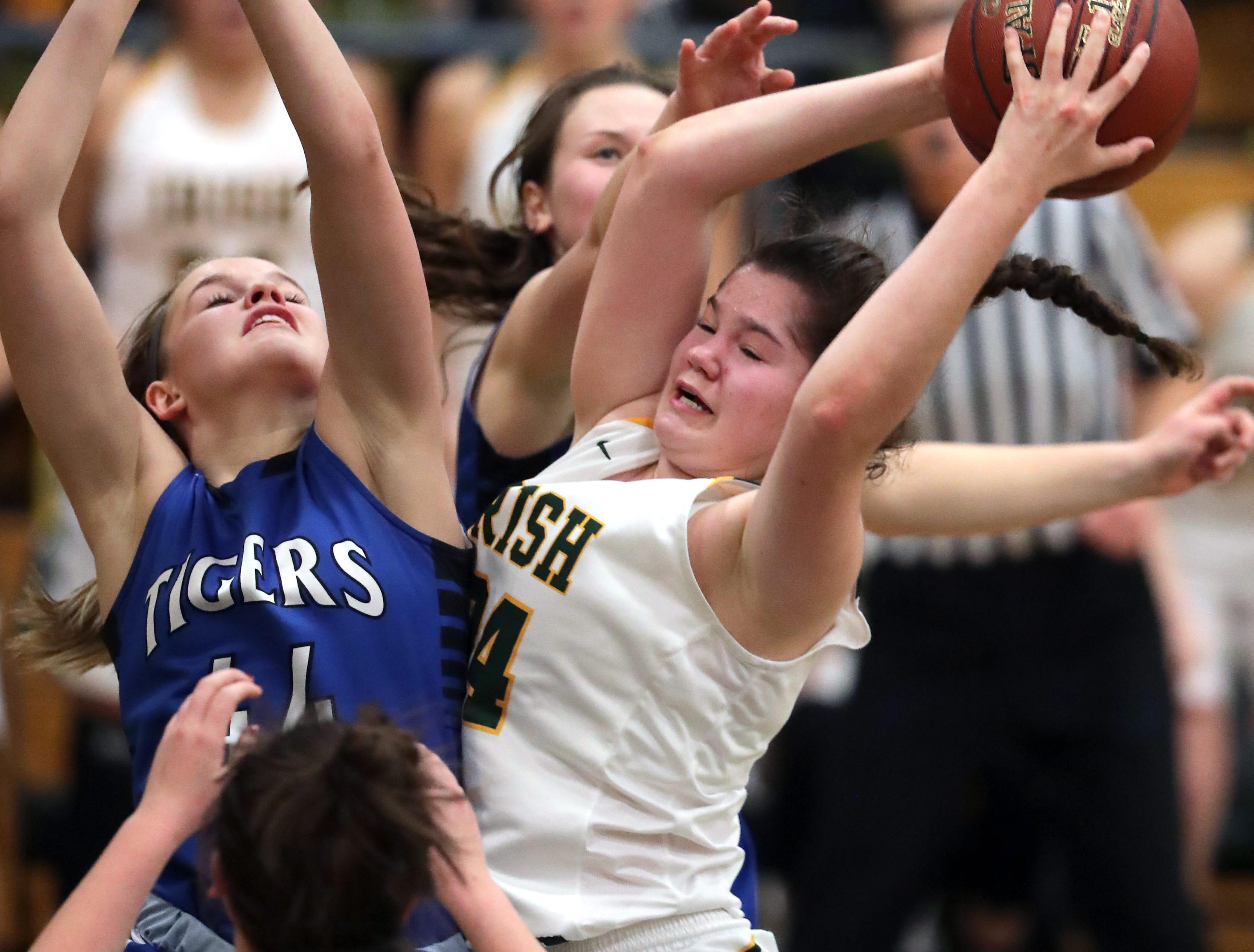 Freedom High School's #34 Linnea Willer against Wrightstown High School's #33 Dayna Van Egeren, #44 Ella Diny and #1 Bridget Froehlke, back, during their North Eastern Conference girls basketball game on Thursday, January 3, 2019, in Freedom, Wis. Freedom defeated Wrightstown 54 to 34.Wm. Glasheen/USA TODAY NETWORK-Wisconsin.