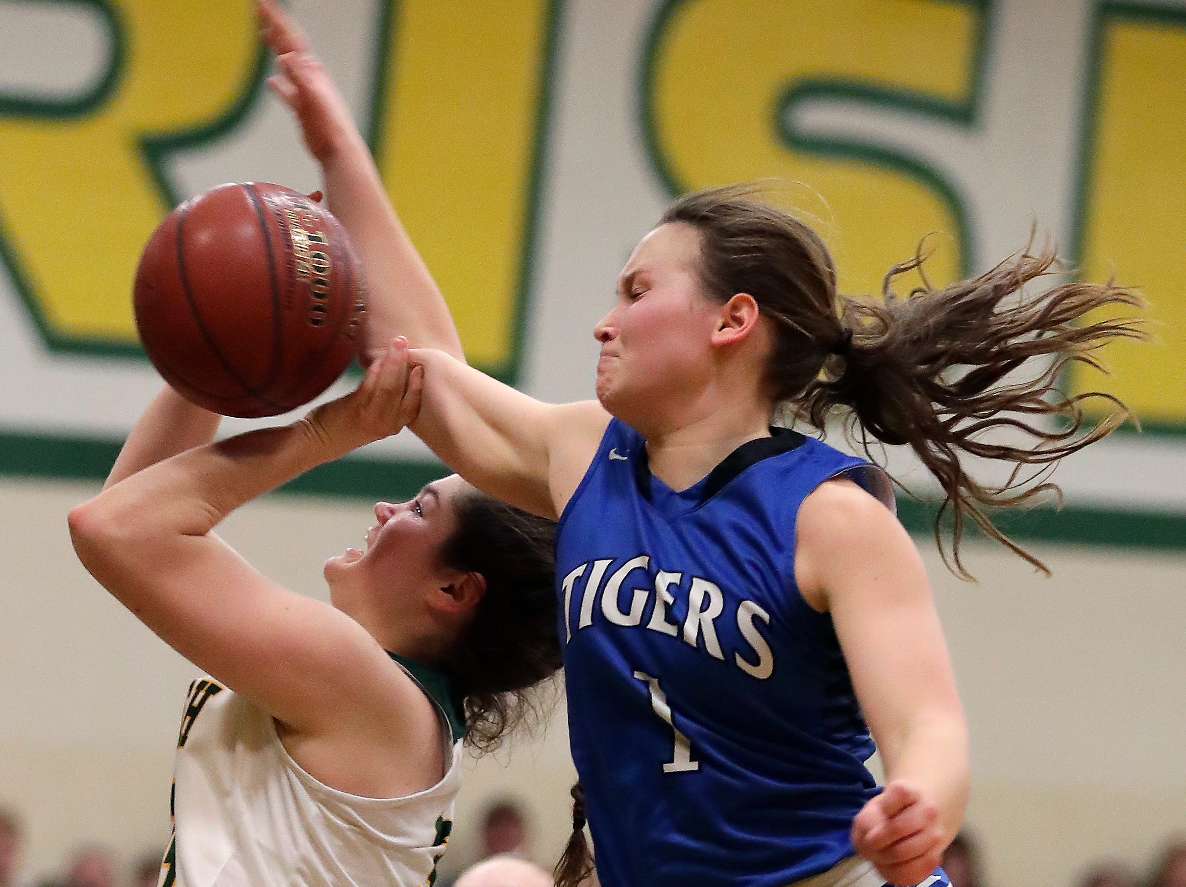Wrightstown High School's #1 Bridget Froehlke against Freedom High School's #34 Linnea Willer during their North Eastern Conference girls basketball game on Thursday, January 3, 2019, in Freedom, Wis. Freedom defeated Wrightstown 54 to 34.Wm. Glasheen/USA TODAY NETWORK-Wisconsin.
