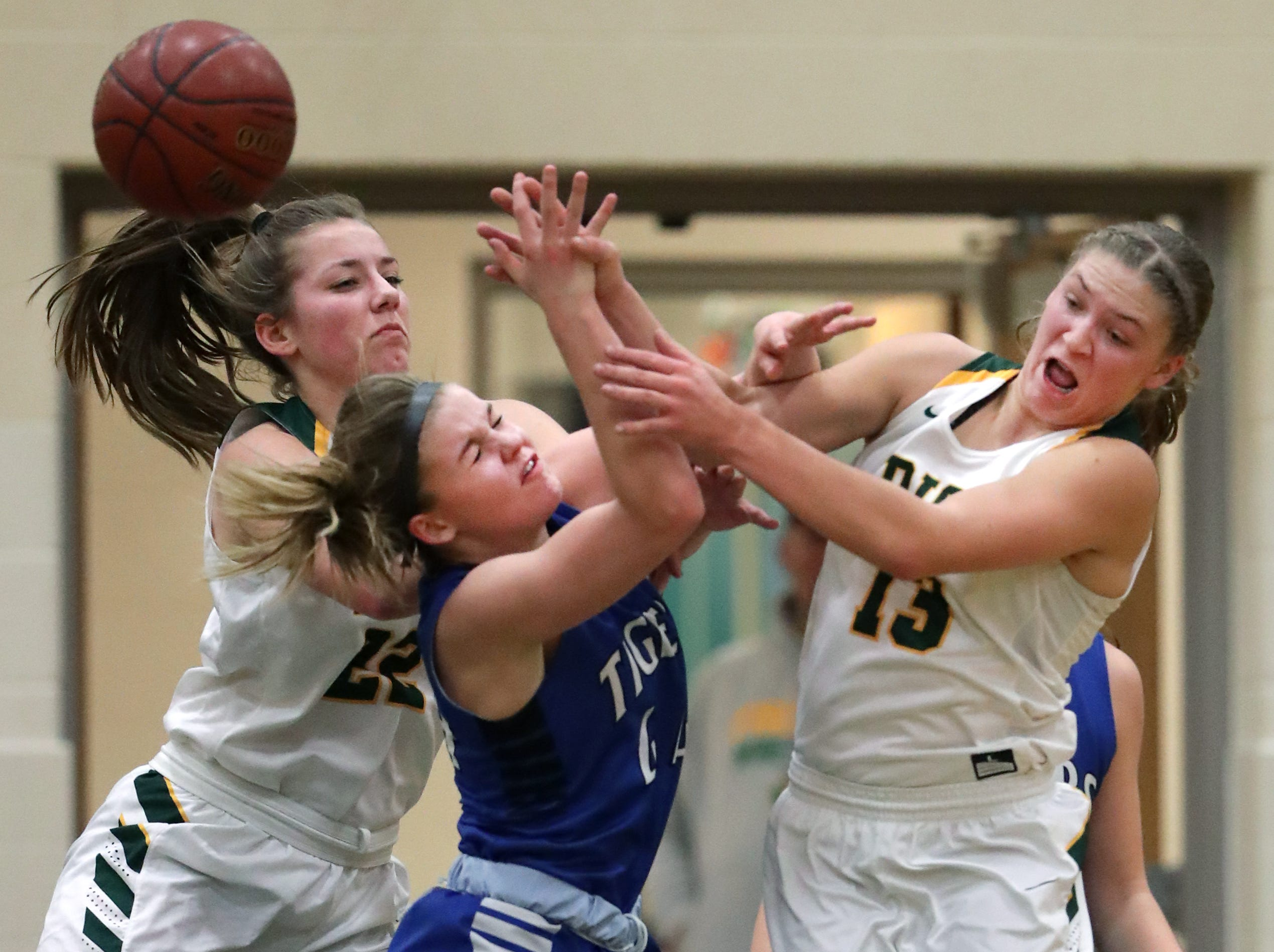 Freedom High School's #22 Taylor Haase and #13 Gabby Johnson against Wrightstown High School's #44 Ella Diny during their North Eastern Conference girls basketball game on Thursday, January 3, 2019, in Freedom, Wis. Freedom defeated Wrightstown 54 to 34.Wm. Glasheen/USA TODAY NETWORK-Wisconsin.