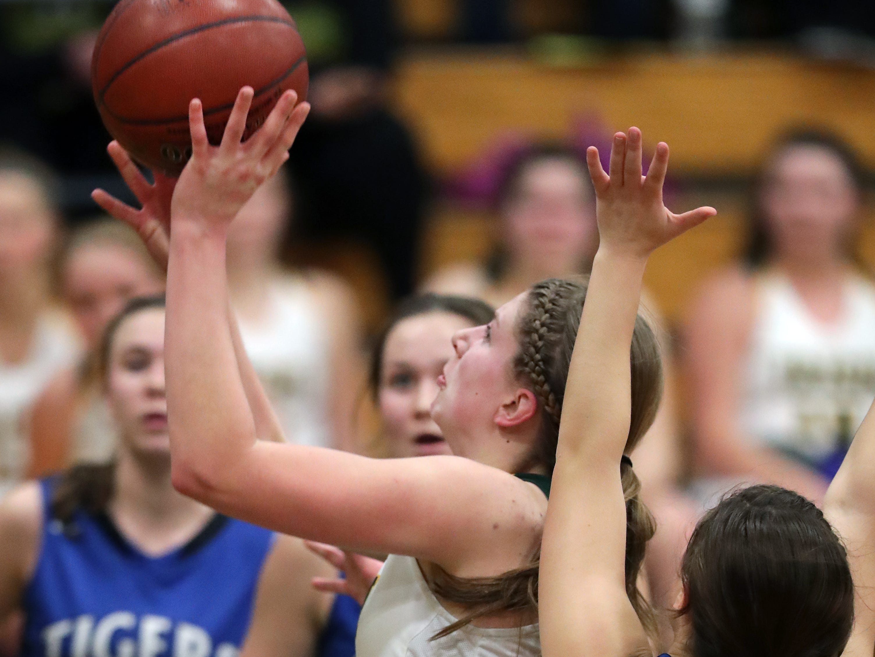 Freedom High School's #14 Karissa Wurster, center, against Wrightstown High School's #14 Tatum Mierow, right, during their North Eastern Conference girls basketball game on Thursday, January 3, 2019, in Freedom, Wis. Freedom defeated Wrightstown 54 to 34.Wm. Glasheen/USA TODAY NETWORK-Wisconsin.
