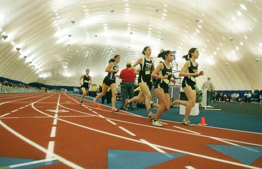 """Runners compete in the John Bennett Indoor Athletic Complex, commonly know as """"the Bubble,"""" in Toms River in this 2007 file photo."""