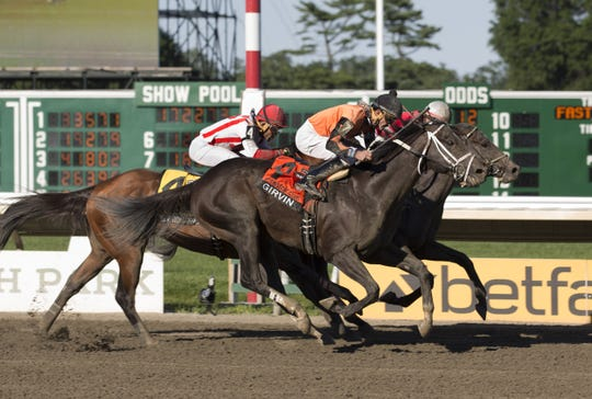 Girvin wins in a tight finish at the 2018 Haskell Invitational at Monmouth Park.